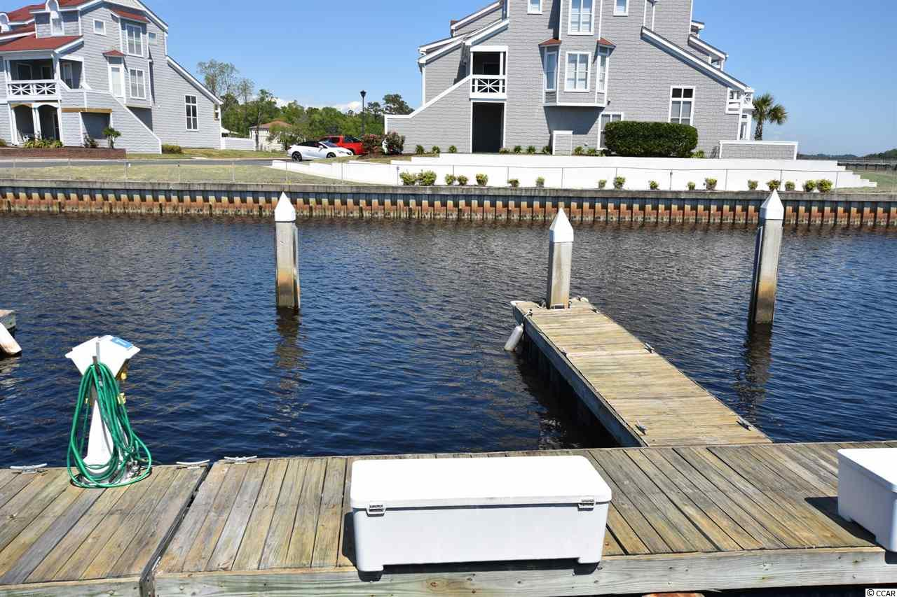 Located in the serene, gated community of Mariners Pointe, this 25'-30' boat slip is one of the closest slips to the Intracoastal Waterway.  Mariners Pointe Marina is approximately 3 unobstructed (no bridges) miles from the Atlantic Ocean. Being the 7th slip from the ICW, you have quick access in and out of the marina.  Slip owners have access to all amenities the community has to offer including pool, hot tub, showers, clubhouse, bar, tennis court and basketball court.  Also included in the low monthly HOA fee is water and electricity at the dock, onsite maintenance, pump out station, dock master and storage bin right at the dock.  The marina has recently been dredged.  Condos in Mariners Pointe are also available for sale.  Mariners Pointe is located in historical Little River, SC home to the Blue Crab Festival, Big M Casino boat and waterfront dining.  All measurements are approximate and not guaranteed.  Buyer is responsible for verification.