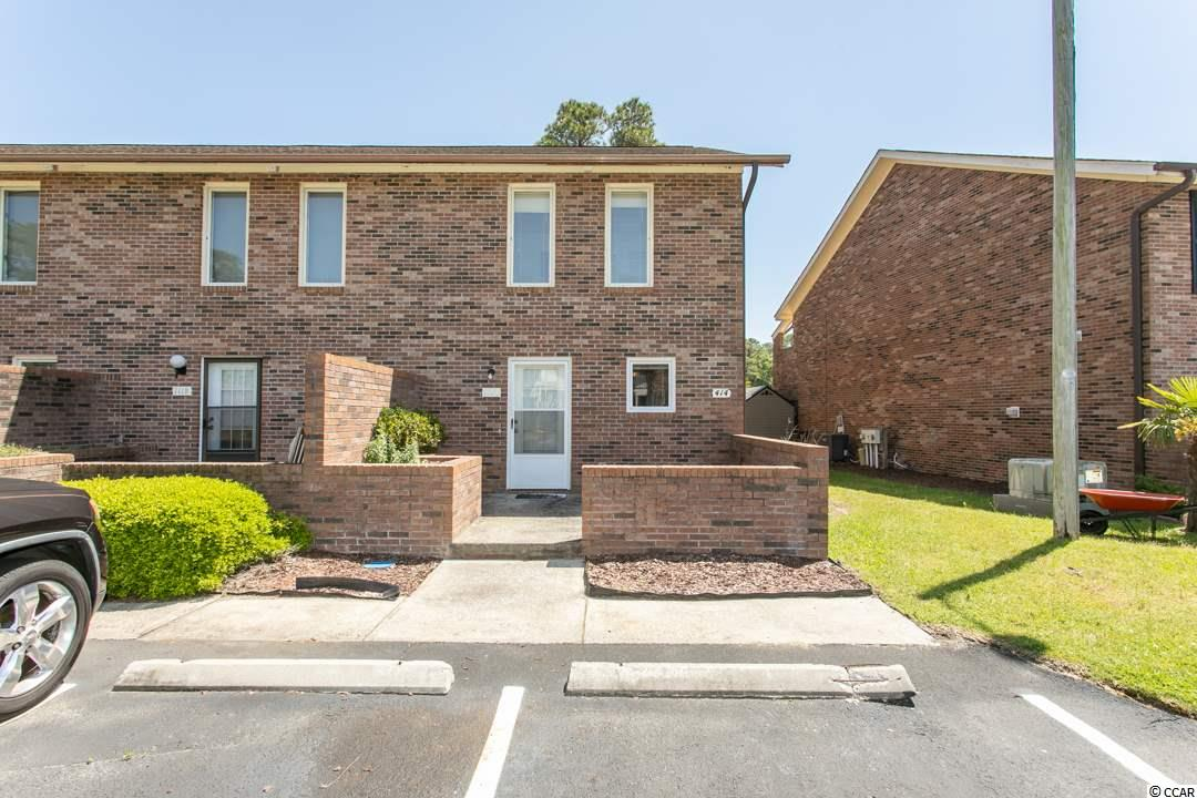 A rare and exciting opportunity to earn a FULL BRICK end unit town-home in Surfside Beach.  This 2 bedroom/2.5 bath town-home is ready for its next owner.  The first thing you notice when you pull up is the nice sized patio located in the front of home. In the rear of the home you will see the covered screened in porch area with outside patio as well as upstairs balcony off the Master bedroom.  Plenty of areas to sit and relax on those beautiful sunny days.  Inside the home you will notice the kitchen area that overlooks the large great room and dining room area. There is also a nice half bath located on the first floor. Upstairs you will see the conveniently located Laundry area with full size Washer and Dryer between the two bedrooms. Both the Master bedroom and second bedroom have their own full bathrooms.  Its like having two master suites! The Master has a large balcony area that has nice views of the pond and backyard area. With low HOA fees it is not surprising that these units do not become available for sale often. This is a true town-home which you own the property underneath. Approximately a mile and a half from the beach and conveniently located to restaurants, shopping, and entertainment. Whether its a permanent or second home you are in the market for add this town-home to your list.