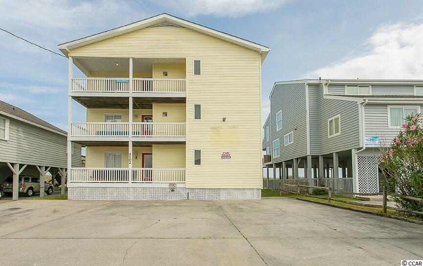 "Welcome to ""Grande Palms""... Cherry Grove vacationing at its finest! Enjoy ocean breezes and spectacular ocean views from the ocean front deck of each level. This 12 Bedroom, 12 bath ""direct oceanfront"" Triplex is designed to rent as 3 separate units. Each unit offers 4 bedrooms, 4 bathrooms, a spacious dining area to accommadate large groups, a full kitchen, washer/dryer, an amazing oceanfront balcony as well as a covered front porch. This property is being sold completely furnished and each bedroom has it's own private 4 peice bathroom and large closet. The first floor unit offers a walk-in handicap friendly shower and features a private hot tub. The stairway is outdoors but enclosed & under-roof. Right outside your back door is a short path through the dunes to the sandy beaches of Cherry Grove. Enjoy all Cherry Grove has to offer with the beach, fishing, and close proximity to all the activities in North Myrtle Beach. THIS IS A MUST SEE with an EXCELLENT RENTAL HISTORY!"