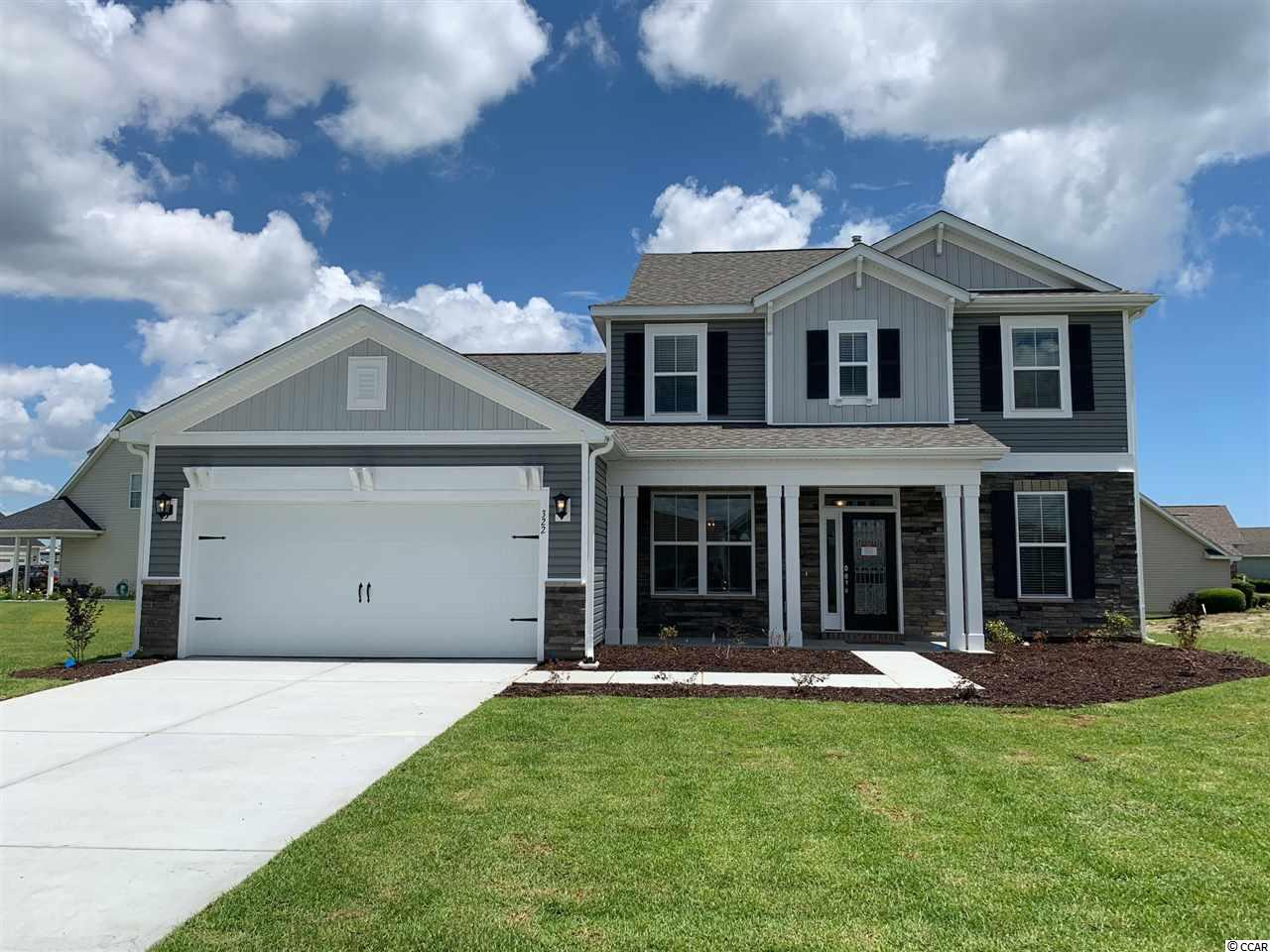 "This lovely Natural Gas ""Millbrook"" home is conveniently located in Belle Mer; the best kept secret on the south-end a few miles from Market Common, between Myrtle Beach and Murrells Inlet.  Belle Mer is located between 17-Business and 17-Bypass, across from South Strand Commons (Kohl's, Lowes, McAllister's Deli), just a bicycle ride to the public beach accesses in Surfside Beach.  This ""Millbrook"" boasts upgraded included features, Energy Star Certification for lower utility costs and a more restful home, an open concept floor plan, and a fresh new design in Belle Mer.  The coastal exterior of this ""Millbrook"" includes a gorgeous decorative glass front door with a sidelight and transom window that leads into a gracious foyer highlighted with natural light, crown molding, chair rail, and picture molding.  The generous open Kitchen features crisp white Level 3 Coastal Shaker style Kitchen cabinets, a ""Light Gray Glossy"" Virtuvian - Subway tile backsplash, White Attica Level 3 Quartz kitchen counter tops, and an Island with 3 Staunton pendant lights that also add to the Coastal flair.  Stainless Steel Whirlpool Kitchen appliances (dishwasher, 5-Burner Gas range with double oven, French style refrigerator, and over-the-range microwave) and a breakfast area.  The spacious owner's suite is luxuriously comfortable with a tray ceiling, Mohawk REV Wood flooring, and a tiled walk-in spa shower.  All living areas of this home include easy-maintenance Mohawk REV Wood flooring.  All baths and the laundry room include tile flooring.  This ""Millbrook"" offers a formal dining room or flex room for a study or den, 2.5 baths, 3 bedrooms upstairs, and the owner's suite downstairs.  The great room ceiling is open to the 2nd floor creating an incredible WOW factor when you enter this spacious, well appointed, easy-living, low maintenance home.  The Belle Mer community includes amenities galore: pool, clubhouse, exercise room, sidewalks, and fishing-canoeing lakes.  This home is ready now!  Start living the ""beach life"" today!"