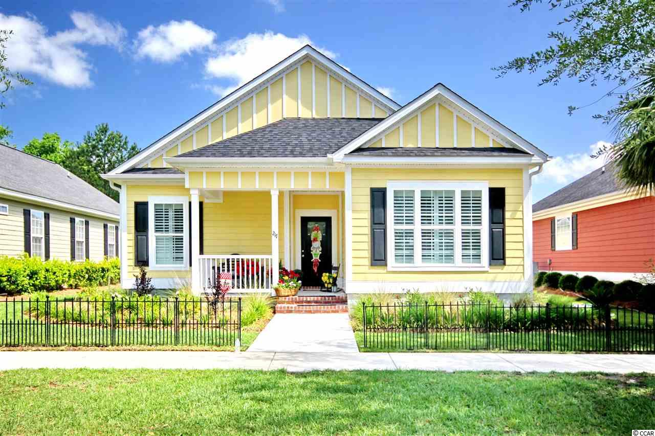 Don't let the front fool you! This home has over 1600 heated square feet and a 2 car garage! It's nestled in one of the most desirable neighborhoods in Conway just 3 miles to downtown restaurants and the Riverwalk area. It's only 30 minutes to Restaurant Row and Tanger Outlet Center in Myrtle Beach via Hwy 22. You'll love The Village because it offers that true southern charm, with a kaleidoscope of Charleston style homes and streets lined with oak trees. Built in 2017, this home features Hardi-plank siding, bull nose corners, 7 inch baseboards, a ship lap accent wall, ship lap around the breakfast bar, tray ceilings and recessed lighting. The homeowner added many upgrades after construction that are sure to please including custom plantation shutters throughout, wainscoting, upgraded fans, and shelving to customize closets and pantry. Mirrors in the bathrooms were also changed from the standard builder mirrors to elegant and stylish mirrors. The kitchen has granite counter tops, ample storage, subway tile back-splash, Samsung stainless steel appliances, easy close cabinets with crown molding and after market hardware. The master suite has a tray ceiling, and the master bath has double vanities, upgraded lighting and shower. All appliances convey, including the washer and dryer. There are pull down stairs in the garage that lead to floored storage space in the attic. This home is exceptional and one you must see to truly appreciate the well thought out floor plan and beautiful finishes.