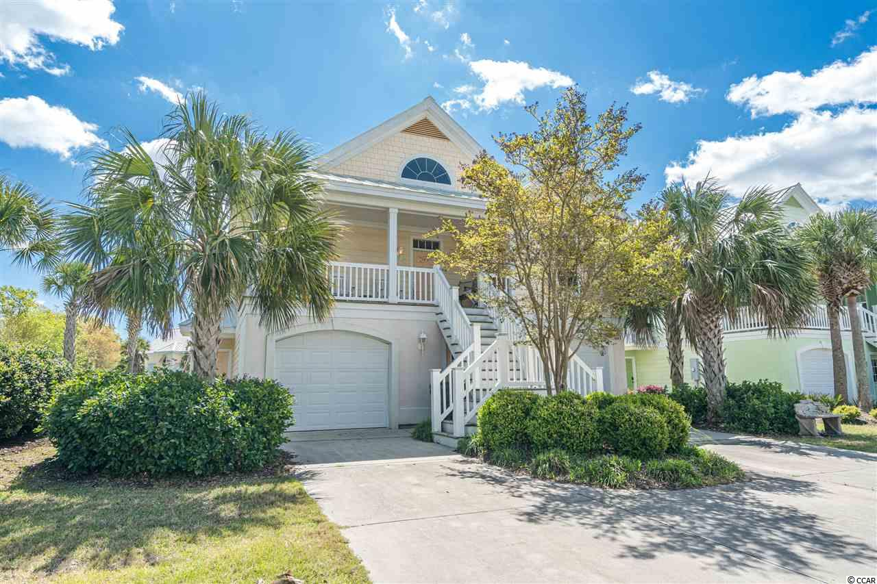 This beautiful coastal style home is located in a Gated Oceanfront Resort Community where Residents and their Guests enjoy private beach access and amenities including: 24 hour patrolled security, indoor/outdoor pools, hot-tub, lighted tennis courts, sand volleyball court, basketball courts, and fitness center. Featuring 5 bedrooms and 4.5 bathrooms with established rental history. This Beach home is as comfortable as it is stylish. Home can be rented out for larger groups or as  2 separate unit's- The lower level (1st floor) has  2 Bed/1 Bath and 3 Bed/2.5 Bathrooms on the upper levels (2nd & 3rd floors). Home is equipped with 2 kitchens, living rooms and laundry areas with private access to both levels. Huge 2 Car Garage with a game room (ping pong & foosball tables), 2 Golf Carts, Bikes, Strollers, Beach Chairs etc. This home comes completely furnished  and ready for you to enjoy for your investment purposes and/or personal use. Call to schedule a showing today.