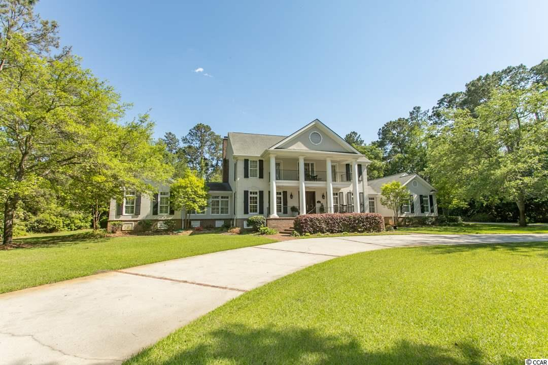 Truly a rare find, this Estate home sits on almost 2 acres, a mile from the Atlantic Ocean in the secluded and gated CLIFFWOOD ESTATES. There is no other community in Myrtle Beach proper with this kind of privacy and large land parcels. Over 5000 heated square feet, this stunning Colonial features 4 bedrooms, 4 baths and 1 half bath, large office , a spacious 3 car garage, 3 fireplaces and upstairs gym. Recent upgrades and enhancements include a gas cooktop in the kitchen, new backsplash in kitchen, fresh paint on the interior, all new light fixtures in the bathrooms, built in cabinetry in the laundry room, marble fireplace and marble buffet in dining room.  So much to take in on this home…hardwood floors, custom cabinets, granite countertops in kitchen, stainless steel appliances, tons of storage, huge screened in area off the family room and outdoor shower. Something is always blooming in the yard! Don't miss this one.
