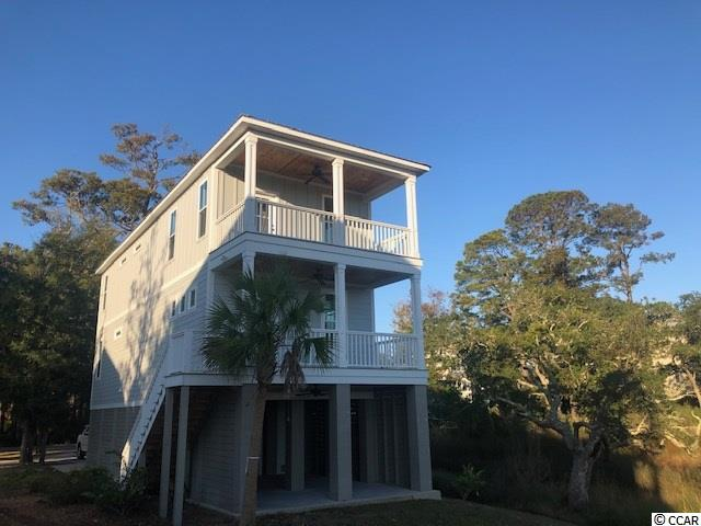 Beautiful CREEK FRONT custom-built 3BR, 3BA raised beach house overlooking the creek between Pawleys mainland and South Litchfield Beach. East of Highway 17, this home is convenient to the Litchfield / Pawleys areas, located in Marshland Park subdivision. Quiet setting where you can enjoy the morning sunrise over the marsh, experience the rise and fall of the tidal creek and all the wildlife that comes with it! Built in 2016 by Original Tyndalll Designs, this home offers an open floorplan, stainless appliances, granite counters and custom cabinets. Interior walls have just been painted. It also has an elevator shaft if you want to add an elevator in the future. Subdivision in process of applying for dock permit. Near restaurants, golf courses, beaches and shopping. Also down the street from Healthpoint fitness center. Hard to match this value in a marshfront home in Pawleys Island.