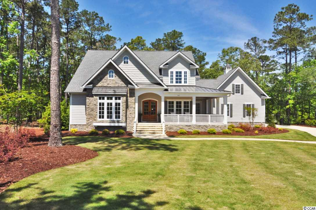 Welcome to 305 Catbriar Hollow Circle, located in the Estate section of Highwood in Murrells Inlet, SC.   Nestled between the pines, the third fairway of the TPC Myrtle Beach, and a quiet cul-de-sac in the back of the neighborhood, this nearly 1.20 acre lot residence was a custom built home by Poulin Custom Builders, LLC in 2017.  But saying custom built does not even begin to describe the features and upgrades that this home possesses.  The meticulousness and attention to detail that was allotted during the construction of this home cannot be portrayed in these remarks.  The unmatched quality displayed throughout the property truly has to be seen in person to understand its magnitude!  The kitchen, which was designed by A & E Kitchens of Murrells Inlet, features furniture end cabinetry, pullout drawers & shelves, custom drawer dividers, etc.  The commercial grade stainless steel exhaust hood is made by Zephr with up to 1200 CFM rating and remote control for hood fan and lighting.  The appliance package consists of the high-end GE Café stainless steel brand with a six-burner gas range.  The kitchen is finished with high-end, upgraded lighting/plumbing fixtures and hardware as well as black leathered granite, Rocco quartz and Carrera Marble countertops.  The solid sculptured, hickory hardwood floors run throughout the first and second levels of this low-country style home. The entry door thresholds and air vent grates are completely seamless without any rises or imperfections.  This attests to the pure custom finishings that are evident throughout this property.  Speaking of air vents, how about a fully encapsulated crawl space with de-humidifiers, concrete pad vs plastic vapor barrier, and an HVAC unit to keep this space airtight, humidity levels controlled to your liking, and your flooring in ideal condition for years to come. This home also features Anderson hurricane impact windows with four over four mullions in each sash.  According to the owner, these windows do not require boarding for storms, while also providing a safe design with a rich, stylish look.  Let's not forget about the master suite!  You will fall in love with this oasis which looks over the gorgeous fairway. Master Bath features begin with the quartz vanity counter tops, upgraded polished nickel fixtures, and custom designed dressing room cabinetry in the master closet.  The standalone soaker tub and oversized custom shower are the showstoppers for this space, that every homeowner dreams of!  Other upgrades and features include (but are not limited to): Aero Electrolux whole house central vacuum system, Emtek (Adams Series) custom made handsets and lockets on all doors, Mosiac Tile flooring in powder room, LP Smartside Siding and Trim, Dual Rinnai Tankless Water Heaters, Kohler Tresham/Memoirs Toilets, Ventless Fireplace w/ custom granite fireplace, all upgraded/custom lighting fixtures, oversized 8 foot by 18 foot garage door, and the list goes on.  Just recently completed, is an additional 900 heated square feet of living space on the second floor of the home, which is evident from the empty spaces in the pictures included in this listing.  This includes one full bathroom, two bedrooms, and finished some closet space while continuing the hardwood floors.  This home also has over 1,000 square feet of walk-in storage under roof in three different areas of the home.  These spaces could be completed as heated square footage if desired.   There are no words that would truly express the quality, professionalism and detail that went into the completion of this home.  This is truly a 1.20 acre estate that is a very rare find in the Murrells Inlet area.  Please contact the listing agent, or call your Realtor, to find out more about this one of a kind home, or schedule a showing!
