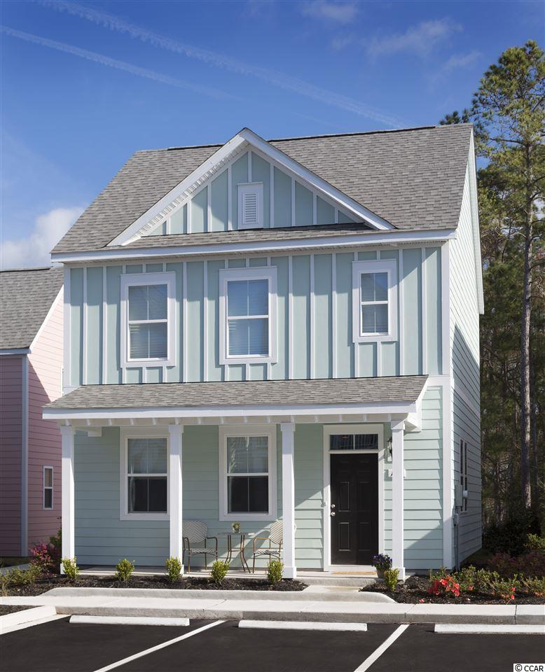This 2 bedroom 2.5 bath Edisto model Charleston style home is located in the Lakeside Battery section of Market Common and just a short walk to downtown Market Common with all of its amenities.   With granite countertops in the kitchen and bathrooms, and a tiled master shower it will be easy to appreciate the thought and care that goes into this new construction home with all the selections from our design center already taken care of.   This home has lawn care included outside of its fenced in  yard and full access to the large pool and lazy river at the amenity center.  Home is built and ready to show and a short, fully sidewalked 1/2 mile walk, bike or golf cart ride to the beach and does not require flood insurance.