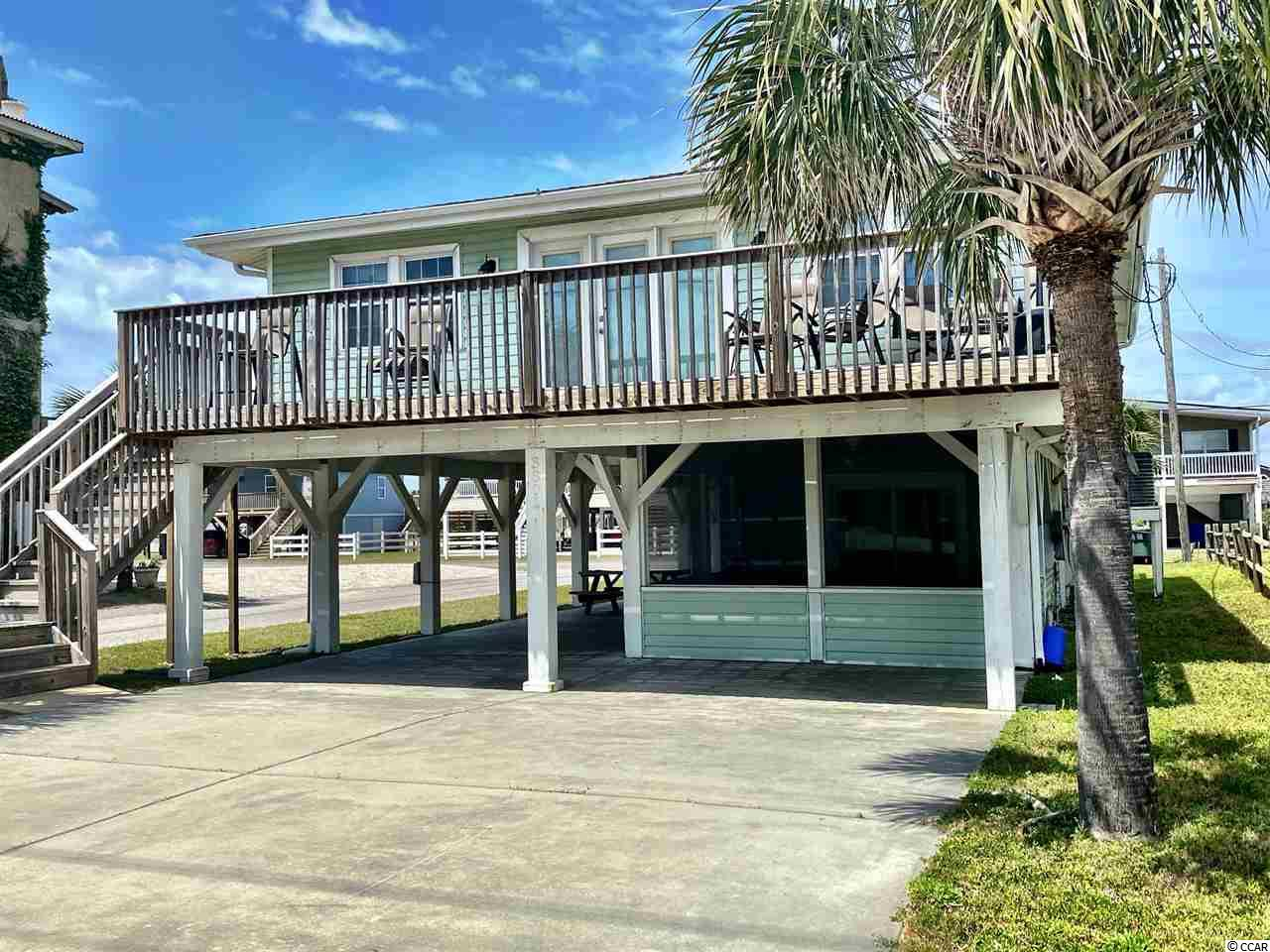 Oceanview!  Just across the street from the beach in family friendly Cherry Grove.  This recently renovated 5 bedroom/3 bathroom home sits on a corner lot.  Granite countertops, laminate flooring, ceramic tile and furnished to a tee all for you, the new owner!  You have the ocean out front and water view out back.  Only used as a second home and it shows!  4 bedroom/2 baths upstairs and a separate one bedroom apartment downstairs!  Enjoy the ocean breeze from your oceanview deck.  You don't want to miss out on this one!