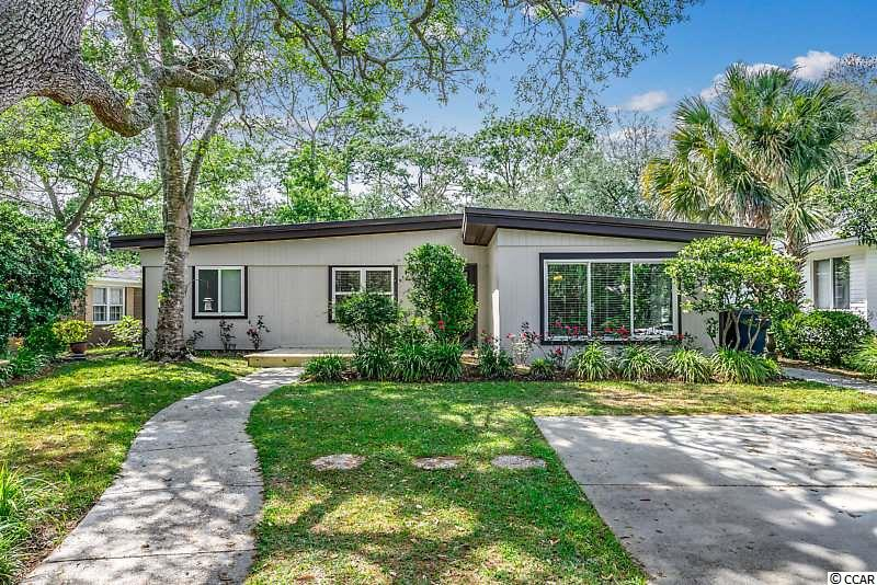***BE SURE TO WATCH THE VIRTUAL TOUR LINKED TO THIS LISTING*** If you're looking for a completely updated, move-in ready home East of 17, look no further! Completely remodeled in 2017, this 4-bedroom, 3-bathroom ranch-style home is nestled amongstlive oak trees and will blow you away with its open floor plan and modern appeal. The entire home has wood-look ceramic tile complimented by neutral paint colors. The kitchen features all stainless steel appliances, granite countertops, a tiled backsplash, recessed lighting, pendant lighting over the large work island and ample cabinet space for storage. It also has two sinks, each with a garbage disposal.The master bedroom leads to a beautiful ensuite bathroom with a large, walk-in, tiled shower, a double vanity and recessed lighting. The two guest bathrooms are equally breathtaking: one with an additional walk-in tiled shower, and the other with a tiled shower/tub combo. You'll love entertaining guests in the large backyard, with a large deck, completely shaded by live oak trees. Store all your beach gear in the detached storage shed. The front deck was just replaced in April 2020. In 2017, the roof, the HVAC unit, tankless water heater and all of the windows were replaced. In April 2019, the sellers also installed a brand new compressor. All this walking distance to the ocean!