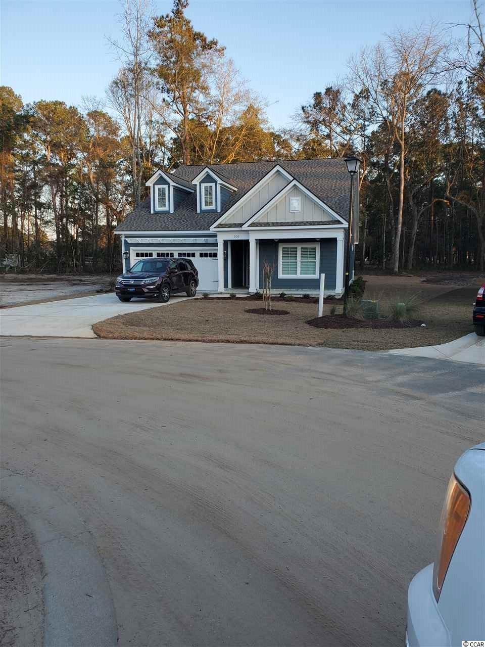 "This home is to be built .... The Simon Plan Located in ""Northwoods""  in Litchfield Plantation is a beautiful floor plan boasts  10' Ceilings in the Main Living areas with crown molding, Open Kitchen/living layout with Granite Countertops, tile back splash, Upgraded Stainless steel appliances, and large Pantry. The Master bathroom offers a separate tub and tiled Walk in Shower, Large Walk in Closet and his and hers sinks with Granite Tops. In the rear of the home you will find a larger covered rear porch overlooking the #3 Green at Willbrook Plantation Golf Course.  All of the homes in Northwoods will impress you with finish and upgrades as well as the quality of construction. Litchfield Plantation is unmatched in our area for its historic beauty. Enter the Avenue of Oaks, and you will immediately feel swept back in time. Northwoods is a brand new neighborhood located within this private and gated community that offers all of the amenities that Litchfield Plantation includes. This is a rare opportunity to own a home in the truly exquisite Litchfield Plantation community in Pawleys Island."