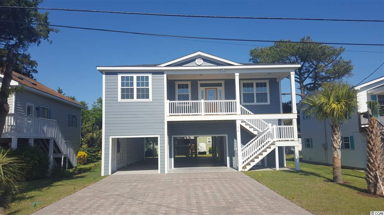 Great location!  Bring your bathing suit and golf clubs. You are a short walk to Cherry Grove Beach, area shopping, and dining and a short golf cart ride to the Surf Club. This to be built raised beach house with 4 bedrooms and 3 full baths, plenty of parking, downstairs enclosed storage and NO HOA offers you everything you need to have a wonderful beach home but yet is far enough off of the beaten path you can sit on 1 of your 2 porches to enjoy your outside.