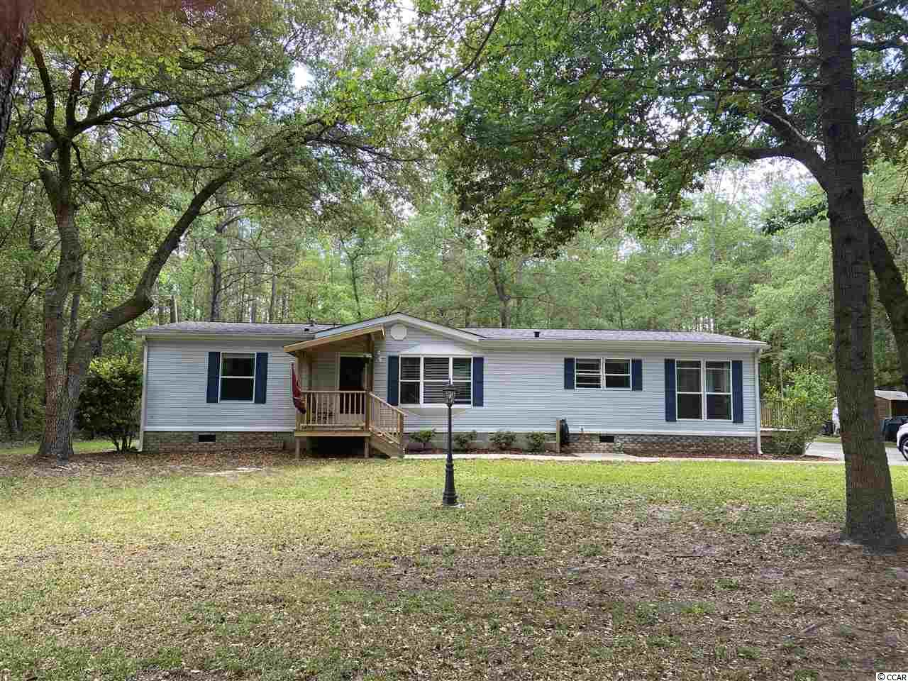GREAT LOCATION OUT FROM THE MAINSTREAM BUT CLOSE TO THE BEACH. THIS HOUSE HAS 3 BEDROOMS AND 2 BATHS FULLY FURNISHED WITH THE EXCEPTION OF A FEW PICTURES ON THE WALLS. THIS HAS JUST OVER 2.5 ACRES WITH NO HOA'S. BUILD YOUR DREAM HOUSE WITH THE ADDITIONAL LAND.