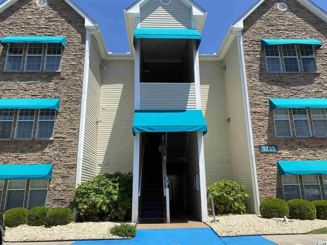 Close to the Beach. A One Bedroom, One full Bath Condo with an open concept and 9 ft. ceilings. Located in the Arcadian section of Myrtle Beach. Unit features new laminate flooring in the living area, tile in Kitchen and Bath area, vaulted living room ceiling, granite countertops, stainless appliances, pantry, a cozy sunroom (could be second bedroom), large master with a walk-in closet, and a separate laundry room all rooms freshly painted. Savannah shores amenities include an amazing pool, tennis courts, sand volleyball court, clubhouse, putting greens, private car washing station, an 8 port golf cart charging station, play area, dog park, and lush landscaping and the development is gated. Private garages are available for a fee.