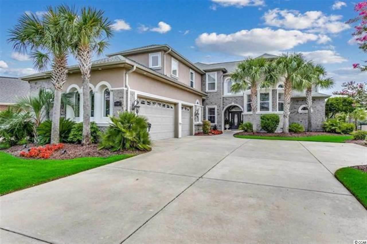 Welcome home to this beautiful 5 bedroom, 4 full bathroom with 2 half baths, home in the prestigious community of Plantation Lakes. This home features all the upgrades and sits on a premium water lot with a private boat dock. As you enter, you will immediately notice the luxurious tile flooring throughout the main living areas, tall tray ceilings, a formal dining room, and a kitchen fit for a chef. The kitchen is equipped with all stainless steel appliances including a gas range, double ovens, custom cabinetry with granite countertops, a large work island, breakfast bar, breakfast nook-separate from the formal dining room, and a spacious pantry! Each bedroom includes a ceiling fan, plenty of closet space, and easy access to a bathroom while the master features the luxurious tray ceilings with recessed lighting, a tiled walk in shower, double sink vanities, an oversized whirlpool tub, and spacious walk in closet. Enjoy afternoons on the back patio, grilling on the built in grill area, and enjoying the views of the lake. A bonus room and loft area can be used as a home office, play room, rec. room, etc. The options are endless with this home. Make this your forever home; Schedule your showing today!