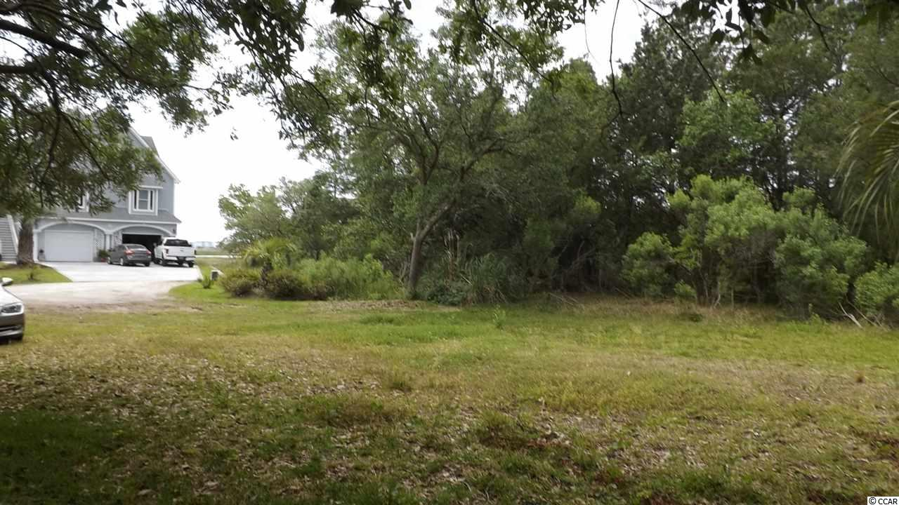 Great residential lot tucked away near the Inlet. A portion of this parcel could be subdivided and sold to an adjacent land owner which would ultimately reduce cost. NO HOA restrictions. Manufactured homes are not allowed.