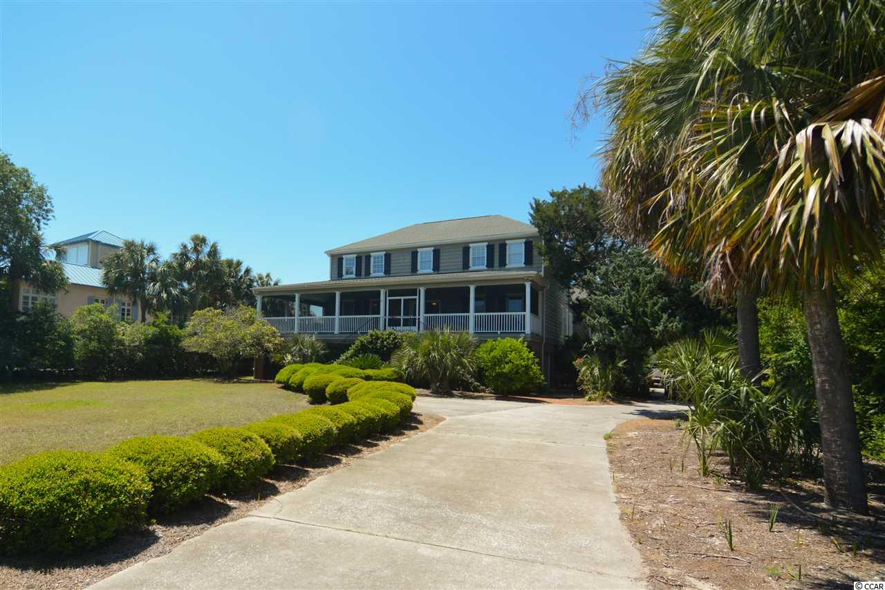 PRICED WAY BELOW TAX VALUE! 5bed/5ba OCEAN VIEW home located 2nd ROW to the beach, on the lake with an ELEVATOR.  Perfect primary, 2nd or rental property. Great open floor plan connects eat-in kitchen, great room, dining room, Carolina room and sun room. Plus there are 2 bedrooms off the sun room side porch for guests to enjoy their privacy but easily be party of the family. Huge front porch, side poch and back porch give your family plenty of room to relax and hear the ocean waves. Tons of storage below including a 4 Bay garage which will comfortably house a boat, 2 cars and golf cart while still having plenty of room for your beach gear. Plus there's a full bathroom downstairs to wash off the sand before coming up to the house. Private courtyard and lake-front yard are surrounded by mature landscaping for maximum privacy. Debordieu is only 70 miles to Charleston, SC and only 30 miles to Myrtle Beach, SC.
