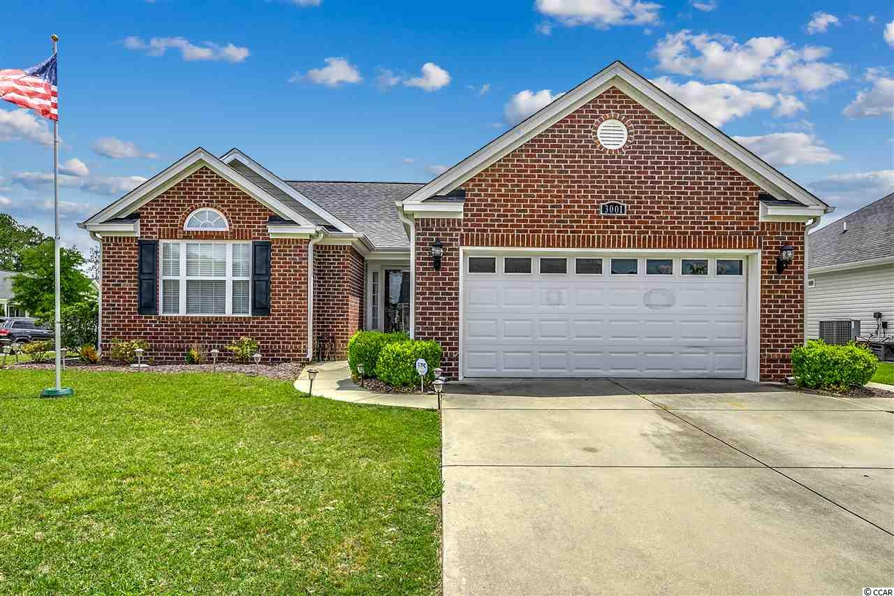 Located in the prestigious Tiger Grand community this home sits on a corner lot. This immaculate home has an open floor plan with beautiful new hardwood flooring, granite countertop and stainless steel appliances. The Carolina room is currently being used as a formal dinning room, but could be used as an extra room for family or friends. A new HVAC was installed in 2018 with a clean air system as well. The master bath has an upgraded shower. Enjoy your morning coffee or evening drink in a spacious screened in porch right off the kitchen. Great for entertaining.