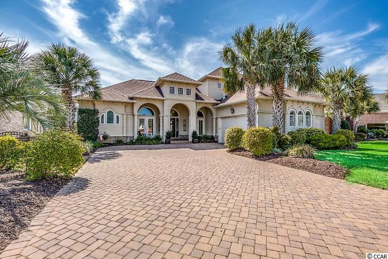 Tucked away in the heart of North Myrtle Beach in the gated community of Seaside Plantation, this lakefront home will check all of your boxes. Built around outdoor living in classic Mediterranean style, all wings surround the large private courtyard for maximum sunlight and plenty of options for lounging al fresco.  Catch some rays on the screened porch, grill on the patio, or enjoy the screened sauna with a breathtaking view of the water. Soaring ceilings in the main living space, along with an open floor plan and windows galore give this home a modern, stylish vibe. The main level includes two bedrooms and a sitting room/office with an entire wing of the house dedicated to the master suite for maximum privacy. Upstairs you will find a lovely space for guests with two additional bedrooms, living room, and covered outdoor deck. Storage space is abundant in this carefully planned custom home with a large floored walk-in attic space, butler's pantry, and oversized closets throughout. Residents of Seaside Plantation enjoy the convenience of nearby shopping, restaurants and world-class entertainment as well as many on-site amenities such as a community center, swimming pool, heated spa and more. Only steps away from Main Street and the ocean, this is one of the most desirable locations in our area. Click on the link to view our floor plans and take the virtual tour of this exquisite home!