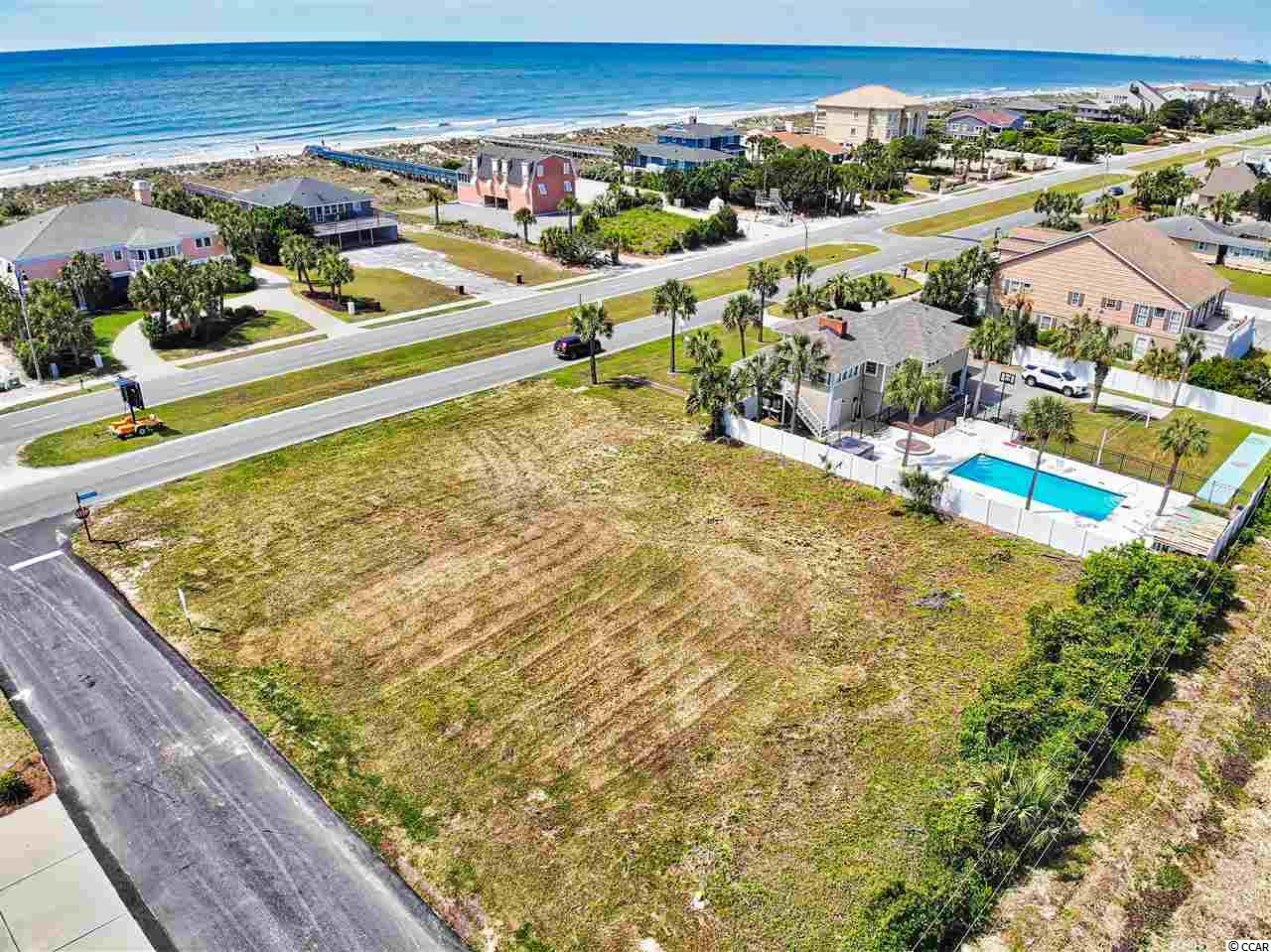 Don't miss this very rare opportunity to own a corner lot in Tilghman Estates section directly across the street from the ocean.  This lot is situated on the corner of 17th Avenue N. and Ocean Blvd. surrounded by some of the most spectacular homes in North Myrtle Beach.  Just steps to the ocean with direct access to the beach across the street.  Golf cart to Cherry Grove attractions or to Main Street for entertainment, restaurants and shopping.  Build your one of a kind dream home and start enjoying beach living at it's best.