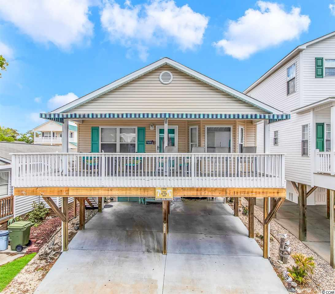 Welcome Home! Location can be found here at this bright, airy, and spacious raised beach home in the award winning Ocean Lakes Family Campground! Just steps from the ocean, this home offers 2 bedrooms and 2 bathrooms. With plenty of parking, covered front porch, an outdoor bar located underneath the property, and storage shed to house all the beach supplies, site 1516 has it all. As you enter the home, you're greeted by a large open concept living space that is directly open to the generously proportioned kitchen. Home offers laminate flooring throughout the living space and bedrooms, vaulted ceilings in the kitchen and living room, ceramic tile counter tops, spacious bedrooms, generously sized bathrooms, and so much more! Perfect for anyone, this home is ideally positioned to enjoy summers by the South Carolina Coast. Home is conveniently located close to all the amazing amenities Ocean Lakes has to offer! Amenities included are indoor/outdoor pools, lazy river, waterpark, mini-golf, arcade, basketball courts, volleyball courts, and much more! Come check out this property today! All measurements are approximate and not guaranteed. Buyer responsible for verification.