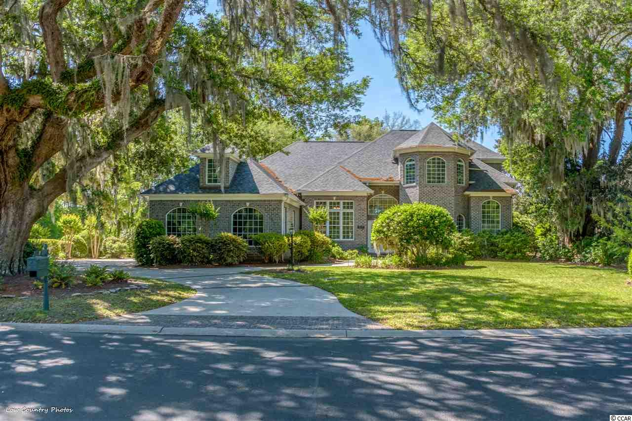 This exquisite home was masterfully designed to take full advantage of the views from this one of a kind home site. Located under a canopy of ancient oaks, this .40 acre home site offers all-encompassing views of the beautiful 50 acre Heritage Plantation Lake, which borders the fairway of the dramatic 18th hole of the Heritage Golf Club. The home also overlooks the scenic 10th hole from the front yard!  From the moment you walk into the home, you are captivated by the architectural details! The 20 foot ceilings, transom and palladium windows enhance the breathtaking view!   Attention to detail is evident in this well-appointed custom home. The living area is complimented by a gas fireplace, custom molding and hand crafted built-ins. This open design flows seamlessly into the study, formal dining area and the beautiful kitchen/breakfast area. The light filled kitchen offers white cabinets and appliances which are complemented by rich dark granite counter tops.  This one was definitely designed with entertaining in mind. The oversized master retreat with sitting area and fireplace is conveniently located on the first floor and also takes advantage of the priceless views from the adjoining Carolina room!  The gracious master bath has double sinks, whirlpool tub, and a large walk-in shower. There is an amazing amount of closet space which makes this a perfect master wing of the spectacular home. Your family and friends are sure to love the privacy of the 2 spacious bedrooms and 2 full baths upstairs which both have magnificent views! The bonus room/4th bedroom has unlimited possibilities and offers a full bath. Add a new roof and 3 car garage with a half bath and you have your dream. This home is located with-in walking distance of the Heritage Golf Club.The Heritage Plantation Owner's Clubhouse offers a 75 ft. pool, fitness area, hot tub and four Har-Tru clay tennis courts. For the boating enthusiast there is a spectacular marina with wet/dry storage overlooking the Intra-coastal Waterway. The Heritage Golf Club is consistently in the top 100 public golf courses.