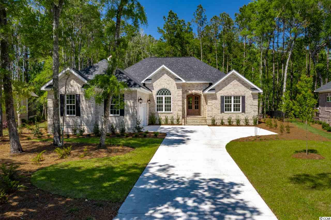 "Located in the ever-popular Reserve community, this new construction home awaits its first owner. Offering 4 Bedrooms, 3 Full Baths, this all brick, custom home offers single level living. The solid hardwood french doors welcome you and your guests into this fabulous home then immediately greets you with an open, airy floor plan.  The great room features a stone, gas fireplace and custom built-in shelving.  The gourmet kitchen is setup perfect for entertaining & features stainless steel appliances, granite counter tops & finished with custom cabinetry.  A picturesque brick archway highlights the private dining area. The master suite is one to be desired. This large suite features a walk-in closet, trey ceilings and highlighted by the spa-like master bathroom that boasts marble counter tops & a tile, walk ""around"" shower.  Other interior bonuses include granite counters in the remaining bathrooms, wide plank, #1 grade Hickory hardwood flooring, private laundry room,  custom hall tree & wainscoting.   Enjoy the outdoor views and sounds from the large screened porch that features another gas fireplace.  The large garage is big enough for two cars and your golf cart.  The Reserve is a gated community with so many amenities.  Golf cart to the beach via private access through the gates of Litchfield by the Sea.  Enjoy easy boasting access to the Intracoastal Waterway via the private marina or join the private golf course and not only enjoy a membership at The Reserve but also 11 other ""championship"" golf courses around the Southeast region.  12 Golf Courses / 1 Membership.   234 Hunters Oak Court awaits you!"