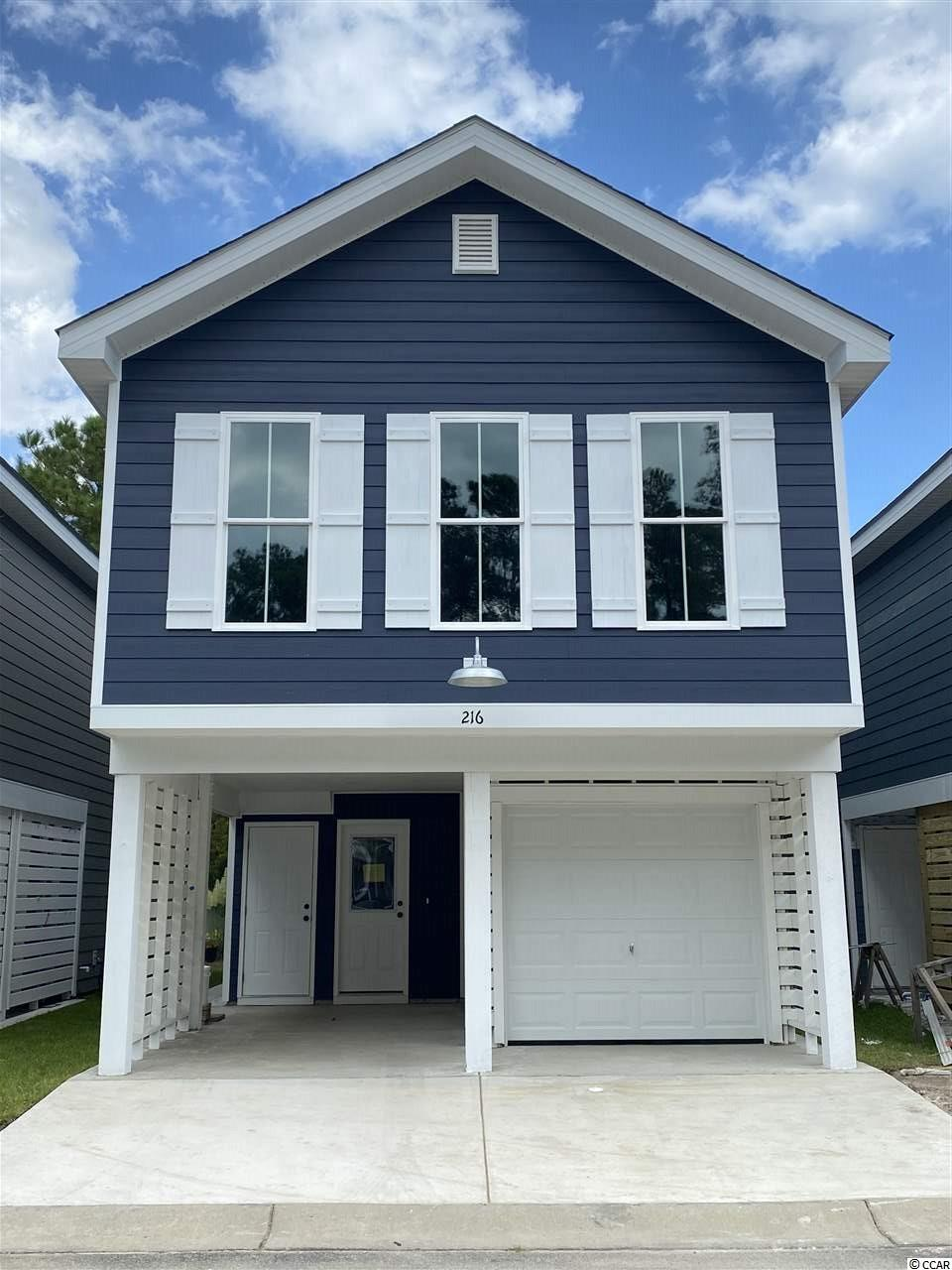 Although only one mile from the Garden City Pier with a golf cart path the entire trip, this home is nestled in a quaint 30 home community with excellent amenities such as a swimming pool and more! This home features Granite countertops in the kitchen, under-mount SS sink, GE appliance package with side by side counter depth fridge, ice maker and water dispenser. The white subway tile backsplash accentuates the quality of the kitchen! Bathrooms include Carrera Marble solid surface countertops with under-mount sinks, shiplap walls and comfort height toilet in the master. Cathedral ceilings in the master bedroom give an open and spacious feel to this home.These ceilings are extended throughout the kitchen into the living room, adding a greater sense of space. To keep the coastal cottage feeling throughout, the living room is accented with a shiplap wall. What really makes this feel authentic is the laminate flooring wall to wall; except wet areas where 18x18 modern tile adorns the floor. There are far too many upgrades to include in this description so contact your realtor or myself to schedule a showing!  Virtual Tour was done on the original model - the only difference is the updated kitchen design.