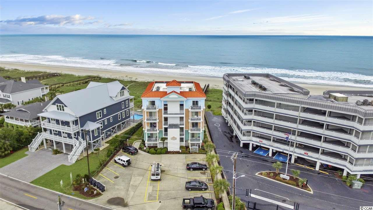 "Now is your chance to own a unit in one of the most sought after buildings in Garden City Beach. This property not only has access to the widest beach in Garden City, but it has access to the day dock and pier across the street at Inlet Pointe! This three bedroom two bath first floor unit is ready to move in to. The master bedroom has a private balcony overlooking the marsh and Murrells Inlet, not to mention the ""spaceship house"" which is one of the most unique homes in the area. The guest bedrooms are of good size with one room housing a queen bed and the other two sets of bunk beds. The views from the spacious living room are amazing. You look right over the community pool to the wide dunes and the beautiful beach. Some amenities of this property include a BBQ grill by the pool, ample seating around the pool, ample parking, elevator, private outdoor storage, stairs with direct access to the pool area, and so much more."