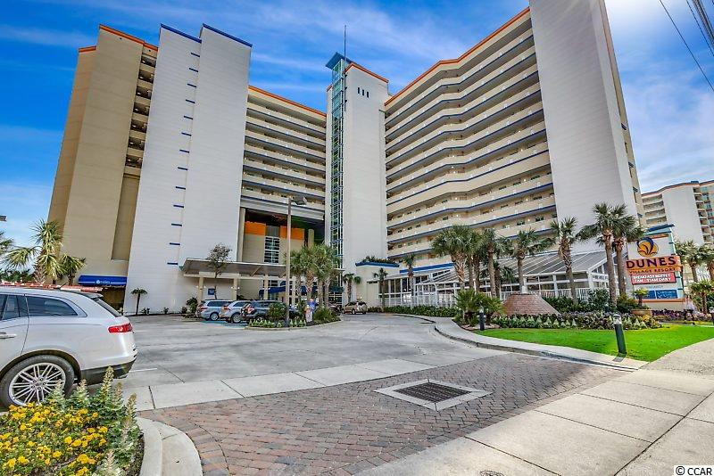 """If you've been looking for an AWESOME 2 BR / 2 BA fully-furnished and turn-key condo in an OCEANFRONT building in the Myrtle Beach, SC real estate market, then you've finally found it.  # 923 Dunes Village is a gorgeous END UNIT with a HUGE wrap-around balcony (there are 3 doors inside the condo to access the balcony - 2 from the large living room and 1 in the owner's suite).  You have a nice view of the ocean and the beach from both the balcony and the owner's suite.   Inside # 923, you'll have a full kitchen with granite counter tops, all-black appliances (dishwasher, stove/oven, microwave, and refrigerator), raised-panel cabinets with brushed-nickel knobs, and a pantry.   Both bedrooms are large with the guest suite having 2 double beds and the owner's suite having a king bed.  Both bedrooms have their own en-suite bathroom with granite sink tops, large mirrors, decorative lighting,  & tiled floors.   The owner's suite bath has a tiled shower as well as a jetted tub.   There is also a sleeper sofa in the living room so you can sleep 8 comfortably in your new condo at the Beach.  There's also an owner's closet where you can keep your personal belongings.  NEW items inside # 923 include:  HVAC (2019); washer/dryer (2019); refrigerator (2019), and the larger Smart TV in the living room (2017).   The most NOTABLE feature of # 923 is the entire western side of the condo is a complete floor-to-ceiling wall of glass with amazing views of the ocean, beach, and the northern part of the city of Myrtle Beach.   Dunes Village is ideally located just north of the downtown area in a more """"residential"""" area.   Dunes Village features every amenity you're looking for in your new condo including:  TWO indoor heated water parks (including pools, hot tubs, sport pools, lazy river, and water slides); outdoor pools, hot tubs, and lazy river; fitness center; onsite Day Spa; onsite breakfast restaurant; onsite bar/lounge and lunch & dinner restaurant; coffee bar; tennis court; basketbal"""