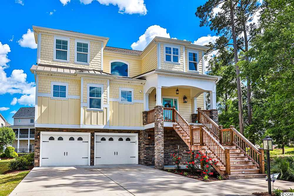 """Stunning Intracoastal Waterway views located on South Carolina's Grand Stand in a premium neighborhood set this 3-story home in a class all of its own.  This gorgeous custom-built home with Elevator showcases craftsmanship, fine design finishes and seamless indoor/outdoor living.  Built in 2018, the 2nd floor has an open plan with Kitchen/Dining/Family Room, Master Bedroom, Laundry Room, and Powder Room.  The Gourmet Kitchen features a substantial Granite island and countertops, tile backsplash, stainless under mount sink, breakfast bar and walk in pantry.  The large Kitchen/Dining area provides an invitation for entertaining family and friends for years to come.  Beautifully maintained, the open Family Room is spacious and has a gas Fireplace.  The Master Bedroom features a full bath with double vanity, tile shower and tub, and custom walk in closet.  Enjoy the breathtaking views of the scenic lake with fountains from your Master Bedroom and relax on your private balcony off the back porch.  The full Laundry Room is located adjacent to the Master Bedroom.  The 3rd floor features a spacious Media Room (13' x 22') for entertaining as well as 3 additional Bedrooms.  The Media Room provides additional space for friends to gather and spend time on the private balcony.  Upstairs also features 3 additional Bedrooms and 2 full Bathrooms.  One Bedroom has a private Bathroom while two spacious Bedrooms share a """"Jack-And-Jill"""" Bathroom.  These additional full Bathrooms also provide the beauty and durability of granite and tile.  The 1st floor houses a spacious front and back load oversized Double Car Garage, Storage Area and Workshop with room for motorcycles and golf carts.  A large Back Patio is also located on the 1st floor and provides ample space for furniture and grill while viewing the scenic lake and fountains.  Hardi Plank siding, Architectural Shingles, New sod installation, irrigation system, with 2 Trane Heat Pumps AND Gas Furnace make this home a Mecca for peacef"""