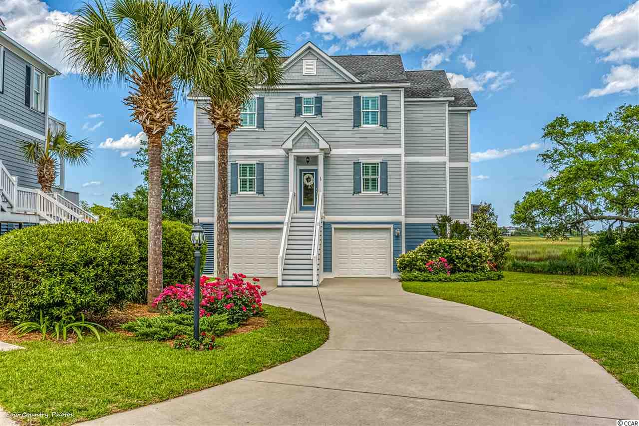 "168 Windy Lane is a unique offering of modern efficient construction and  design that leverages the best of beach living with magnificent views of the inlet, marsh and ocean of Litchfield and Pawleys Island, SC. This wonderful home was constructed in 2016 and incorporates an inverted floor plan with outstanding features far above the norm including: elevator, impact hurricane windows and doors, tank-less water heater, Hardy- board siding,  LED lighting, fireplace and much more. A quick ride up the elevator drops you off on the top floor living space with an open floor plan and breath taking view from every vantage spot.  The large living room features a fireplace and opens to a wonderful covered porch overlooking the inlet. The living area flows to an open dining and kitchen featuring granite counter top, stainless appliances, and wonderful large island with window wall views of the marsh. The top floor is completed by an office/den with marvelous glass doors and a large storage room. Down a level, the second ""sleeping"" floor features the master suite with private porch and large walk-in closet, two bedrooms and bath plus a spacious and efficient laundry room. Special care was invested in the bath rooms featuring porcelain tile, walk in showers with frame-less glass enclosures, and granite counter tops. The ground level contains secured parking and lots of storage and an intimate covered patio. Thoughtful design, superior construction, meticulous maintenance make living easy, the view makes living a dream come true!"