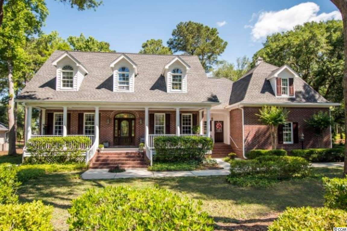 Welcome to true Low Country luxury with a stunning view in this beautiful executive home on an oak-lined drive, designed by award-winning designer, William Poole. His designs are the epitome of fine southern architecture and this home lives up to its pedigree. Set on the green of the scenic 5th hole of Heritage Golf Course, you can relax in your peaceful Carolina Room or enjoy the breathtaking view from the full-length front porch. Spacious 1st Floor Master Bedroom looks out over the golf course as do the kitchen & family room, kitchen boasts stainless steel appliances and brand new quartz island (2020) and more than enough room for family and guest. Brand new Flo-Rite seamless gutters installed June 2020 help keep the rain moving in the right direction. Brand new Merlot-colored washing machine & dryer will convey as will the mounted wine fridge. This house has tons of storage and both a front & back staircase. Don't worry about a thing, seller is including an American Home Shield home warranty to transfer at closing. Set along the Intracoastal Waterway, Heritage Plantation includes a private deep-water marina, tranquil marsh views and a world-class golf course consistently on the list of top 100 public golf courses. Amenities also include an Owner's Clubhouse, four tennis courts, a large owner's pool & hot tub, fitness center and billiard room. Close to beaches, shopping and wonderful restaurants...come home to the Low Country, come home to Heritage Plantation.  All measurements and square footage are approximate and not guaranteed. Buyer is responsible for verification.