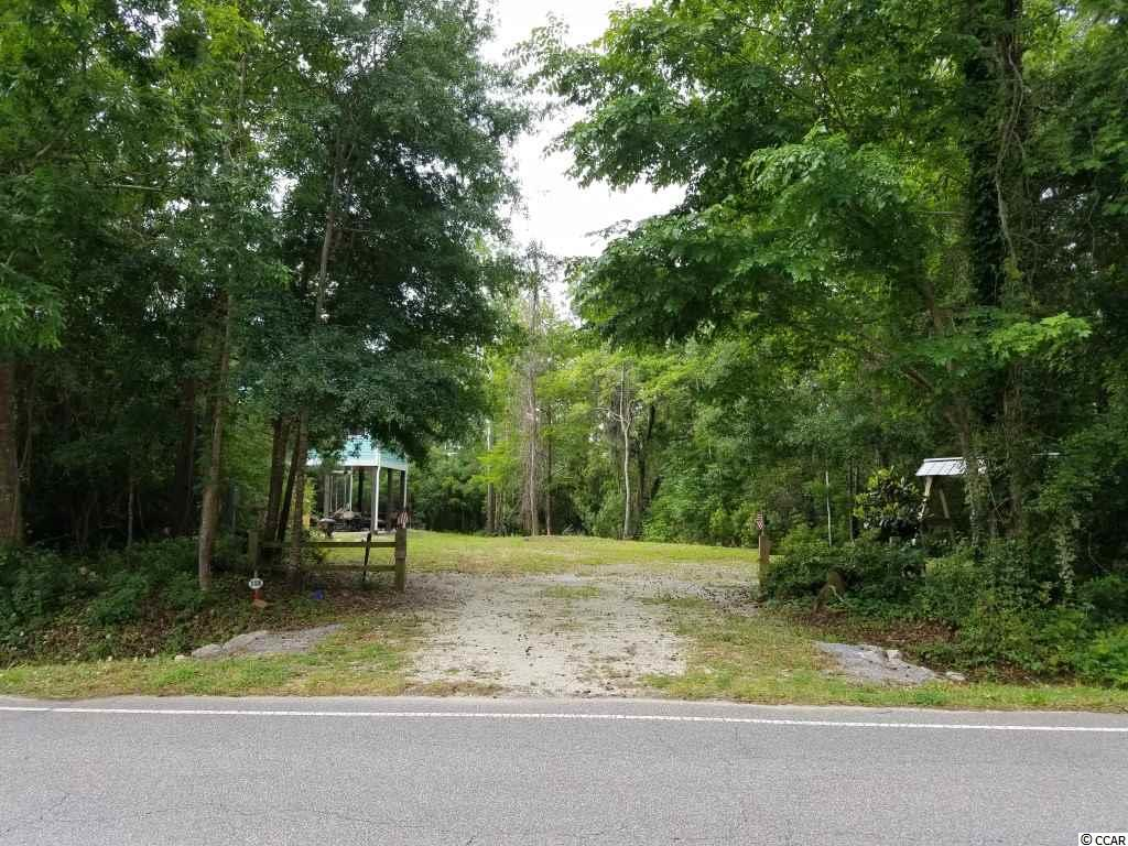 Located 3 minute golf cart ride to the beach! Walk to marsh or beaches with local fishing off the S. Causeway bridge. Close to excellent dining and grocery stores. Golf cart to just about everything locally. Minutes away from the Hammock Shops, Marsh Walk and 60 miles from Charleston. Stubbed in for sewer. Elevation certificate available. Bulkhead already on lot. Lot dimensions approximate only.