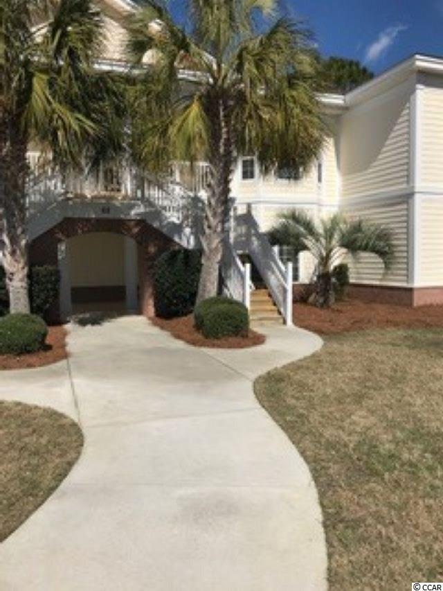 Beautiful updated 4 bedroom/3 bath furnished villa with a private garage. Only a short golf ride to dining, grocery store, library, and of course the great Atlantic!   This highly sought after 1st floor villa is located on the private Reserve golf course with great views from the back porch and patio. This end unit home is also located in the last building in the back right hand corner of the property. This is the most private area in Greenhaven and has lots of green space to enjoy! Kitchen features tile flooring, stainless steel appliances, granite tops, and breakfast bar. Very large and open living area that leads to the back porch and your golf course view.  Owners enjoy private beach access to Litchfield By The Sea with a large deck, restrooms, lots of parking and even golf cart parking which is wonderful.  8 lighted tennis courts, fishing and crabbing, walking and bike paths, and a beach clubhouse that can be rented by owners for most any activity. This one will not last long.