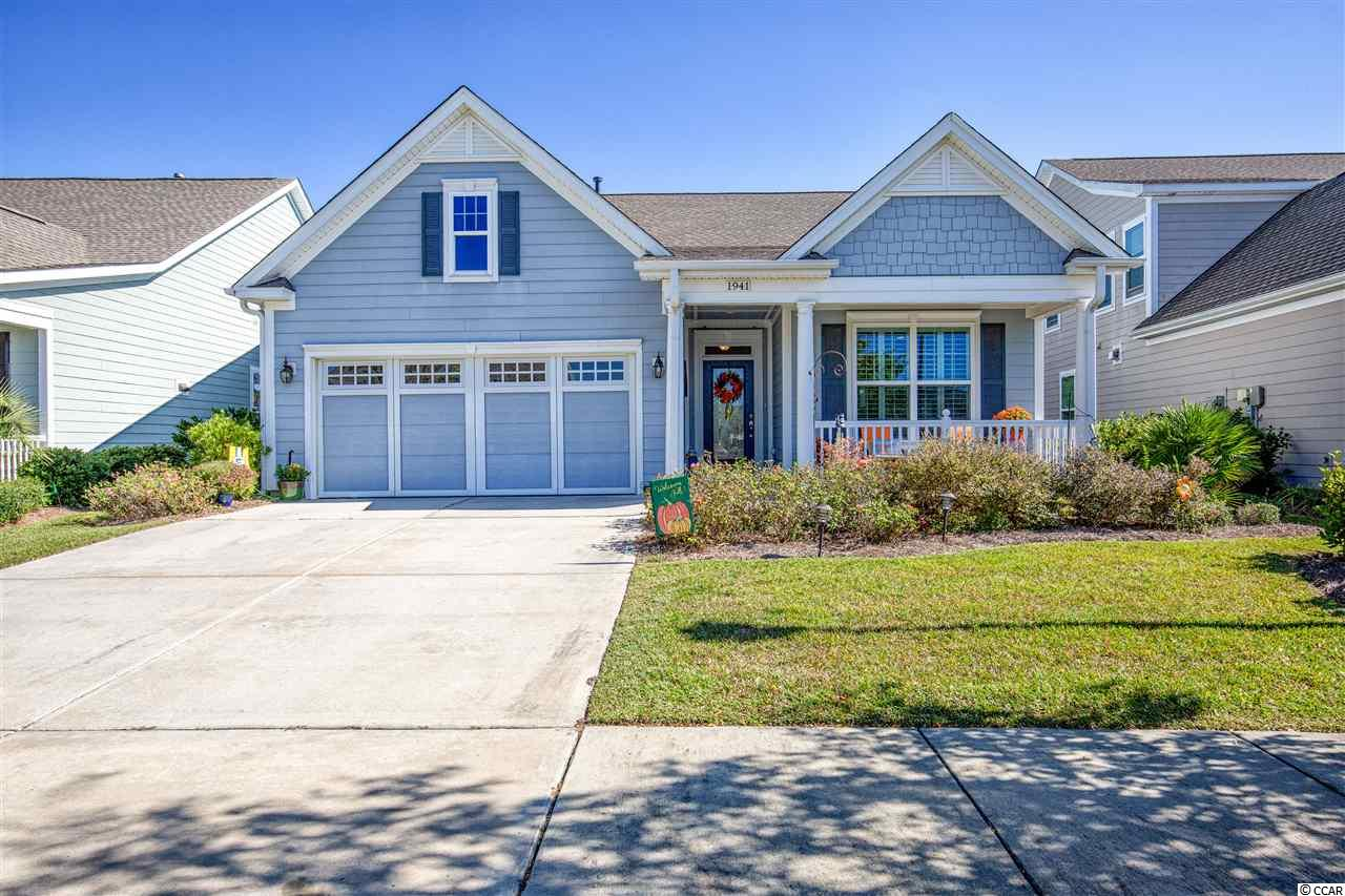 Stunning Ashford model In Cresswind, the most highly sought after active adult community in Myrtle Beach. This bright and airy home features an open floor plan with spacious living areas and bedrooms. You will first notice the beautiful hardwood floors throughout the family room, dining area, kitchen, foyer and breakfast nook. There are tile floors in the bathrooms and laundry room, and upgraded carpeting in the bedrooms. Stylish crown moulding throughout the home adds character and warmth. The spacious kitchen features granite counter tops, stainless steel appliances with gas range, breakfast bar, ample cabinet storage with work island, updated subway tile backsplash, and decorative plantation shutters on the windows. The master bedroom suite features a tray ceiling, his and her closets, and an oversized walk-in tiled shower with seating. The exterior of the home is hardy plank siding and offers a welcoming front porch where you can watch the sunset. A large screened back porch, and an extra large patio with pergola, allows you to relax in the sizable fenced-in back yard and watch the sun rise. Custom shelving has been installed around the perimeter of the garage which allows for greater storage capacity. The garage also has pull down stairs and over-garage storage. This natural gas home  features a tankless water heater. The monthly HOA includes all lawn care, irrigation, cable, security system, a 12,000 sq. ft. clubhouse, resort-style pool with cabanas and a hot tub, fitness center, tennis courts, pickle ball courts, bocce ball, horseshoes, outdoor amphitheater, outdoor fire pit, indoor and outdoor kitchens, miles of walking trails and much more! Cresswind is located within Market Common and just a quick golf cart ride to the beach and Myrtle Beach State Park, and a short distance to the airport, Coastal Grand Mall and Murrells Inlet MarshWalk waterfront dining. Don't miss out on this incredible home so you can live this fabulous lifestyle!