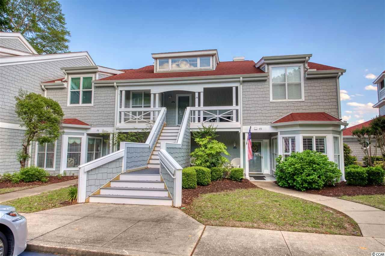 """This cheerful villa in Mariner's Pointe is truly one of a kind and has undergone extensive renovations, including a hallway and bedroom addition on the second level.  There are so many special features for the discriminating buyer:  open and airy floor plan; hardwood floors in kitchen and foyer with tiled floors in baths; granite tops in kitchen with cook top, double oven/microwave; custom cabinetry and built-ins with designer hardware; granite fireplace enhanced by mantle and hand carved sea horse corbels; large walk-in shower in Master bath; 36'"""" vanities with double bowls in both Master and guest baths; upgraded door hardware and indirect lighting (all on dimmers) throughout; and trex decking on both screened porch and deck area.  This condo is being sold furnished with a just a few exceptions.  Incredible views of the 116 slip private marina and the Intracoastal Waterway!  This is a property to see!  There is not another unit like this one in Mariner's Pointe!  Please check out our 3D virtual tour! Mariner's Pointe offers an array of amenities:  pool, hot tub, clubhouse, private lounge, and tennis and basketball courts.  The community is located just a few blocks to the restaurants and activities on the historic Little River waterfront."""