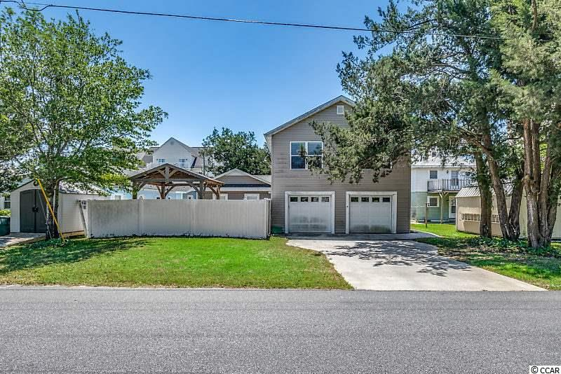 "This gorgeous 5 bedroom / 4 bath beach home is ideally located just one block from the ocean and NO HOA! Never rented and is perfect for your primary home, vacation retreat or rent to vacationers! The seller has made several upgrades including a new roof and HVAC in 2017, remodeled bathrooms, kitchen, custom paint throughout and more. The beautiful remodeled kitchen boasts with stainless steel appliances, tile back splash, 42"" cabinets, granite counter-tops, pantry, recessed lighting, and a work island. The spacious master suite is located on the first floor with stunning  wood ceiling and walls. Relax in the remodeled master bath with custom tile shower, tub, vanity and tile accent wall that matches the shower. Upstairs there are two additional bedrooms that each have their own remodeled bathrooms, along with a living room area. Sit in your screened in front porch as you take in the amazing sounds of the ocean.  while enjoying your morning coffee. Enjoy the privacy of the fenced in backyard with a patio and room for inground pool! Only a short walk, bike or golf cart ride to the breathtaking sunrises, sunsets and sandy beaches of the Atlantic Ocean! Don't miss the opportunity to have your own piece of PARADISE and schedule your showing today!"