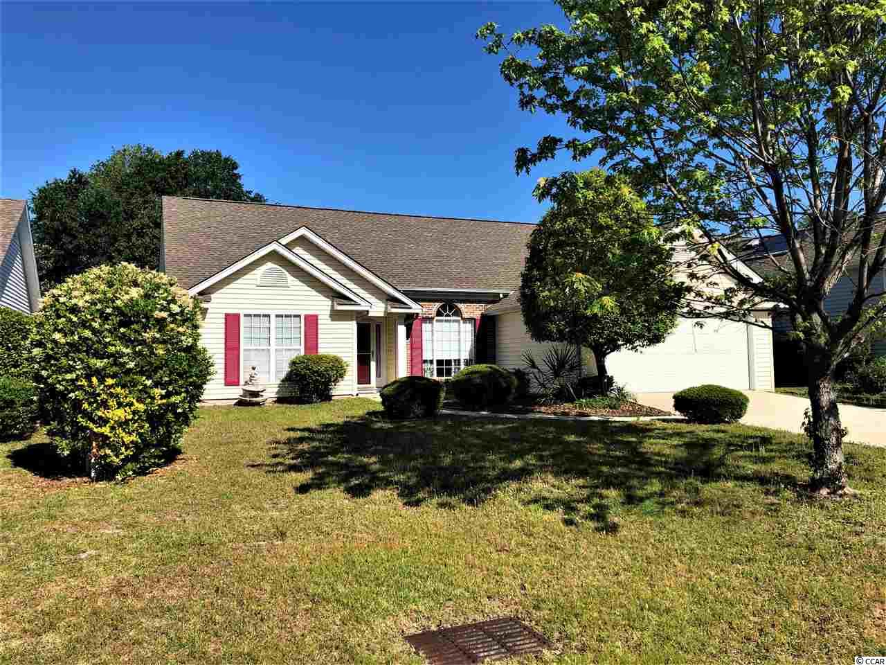 Plenty of space and a short ride to the beach from this 3 bedroom and 2 bath home in Ashton Glenn.  Lots of space in this one.  Large kitchen with lots of cabinet and counters, and living space combo plus the main living room and formal dining area.  Master suite with a large bathroom and walk-in closet in the back, and two guest bedrooms in the front.  Laundry room leading to a large two car garage, plus attic storage above.  Back patio with a retractable awning offering plenty of space for entertainment.  Community pool and just a couple of miles to the sand in Surfside Beach.  Make this one home today!