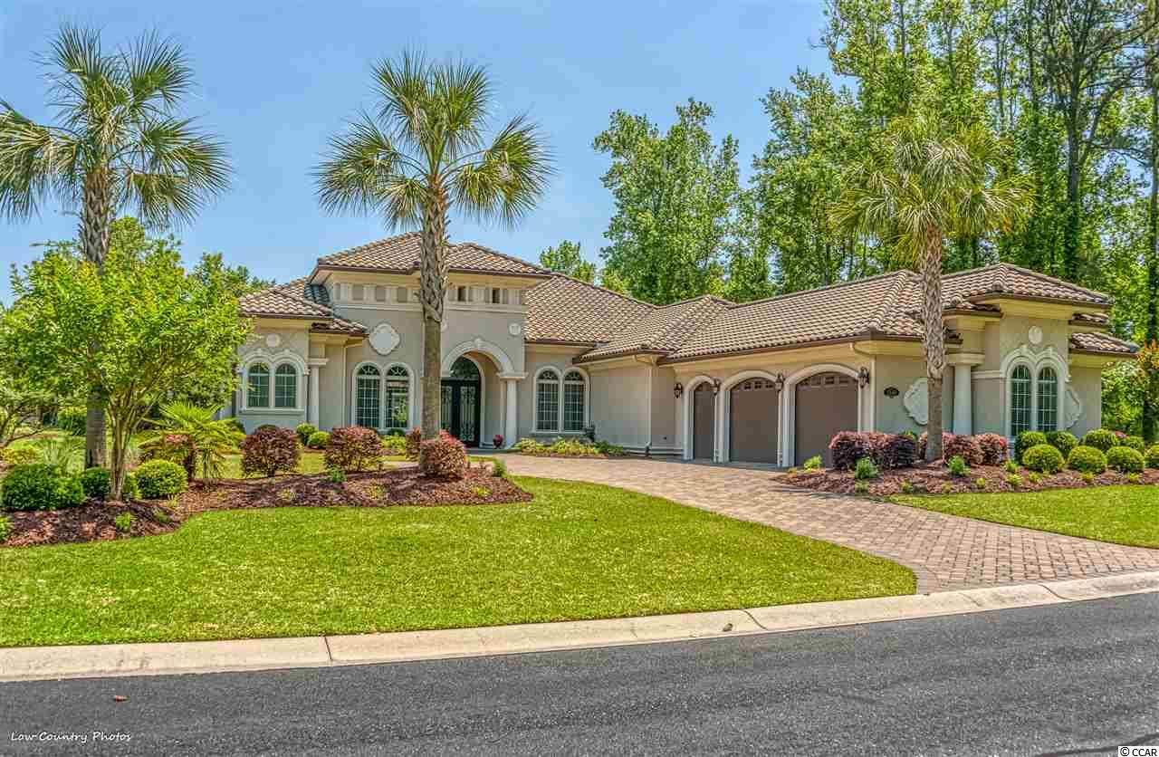 Fantastic custom home in Immaculate condition over the bridge in Grande Dunes.  Situated on a beautiful lake site, this one has over 5000 square feet under roof and features 4 BR plus office, 3.5 baths and 3 car garage.  Quality everywhere the eyes take you, with extras galore!!  Iron front door, custom moldings throughout, hi impact windows and sliders, NEW GAS COOKTOP, granite tops, custom cabinetry, porcelain tile floors, stainless appliance, walk up storage in the garage, and so much more.  Outside you will find gorgeous landscaping, private, screened in patio, LED lighting, French drains and peaceful lake views.  Come experience the finest of homes in one of the best resorts in the Carolinas.  This property is located in South Carolina's premier coastal community in Myrtle Beach; Grande Dunes.  Stretching from the Ocean to the Carolina Bays Preserve, this 2200 acre development is amenity-rich and filled with lifestyle opportunities unrivaled in the market.  Owners at Grande Dunes enjoy a 25,000 square foot Ocean Club that boasts exquisite dining, oceanfront pools with food & beverage service, along with meeting rooms and fun activities.  Additionally, the community has two 18-hole golf courses along with several on-site restaurants, deep water marina, Har-tru tennis facility and miles or biking/walking trails!  Please visit our sales gallery located in Grande Dunes Marketplace to learn more about this amazing community you can call home.