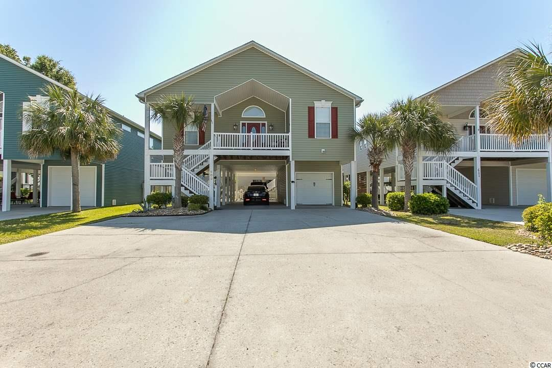 Spectacular location with NO HOA and only 6 blocks to the ocean! This is a beautiful well maintained 4 BR/3 BA raised beach house that is located in Cherry Grove and just a short golf cart ride to the beach.  The home has an open living area with high ceilings and lots of natural light, stainless steel appliances, beautiful counter tops, and back splash in the kitchen, plantation shutters in every room,  new hot water heater, screen porch and outside shower.  Schedule a showing today and come make this home yours.