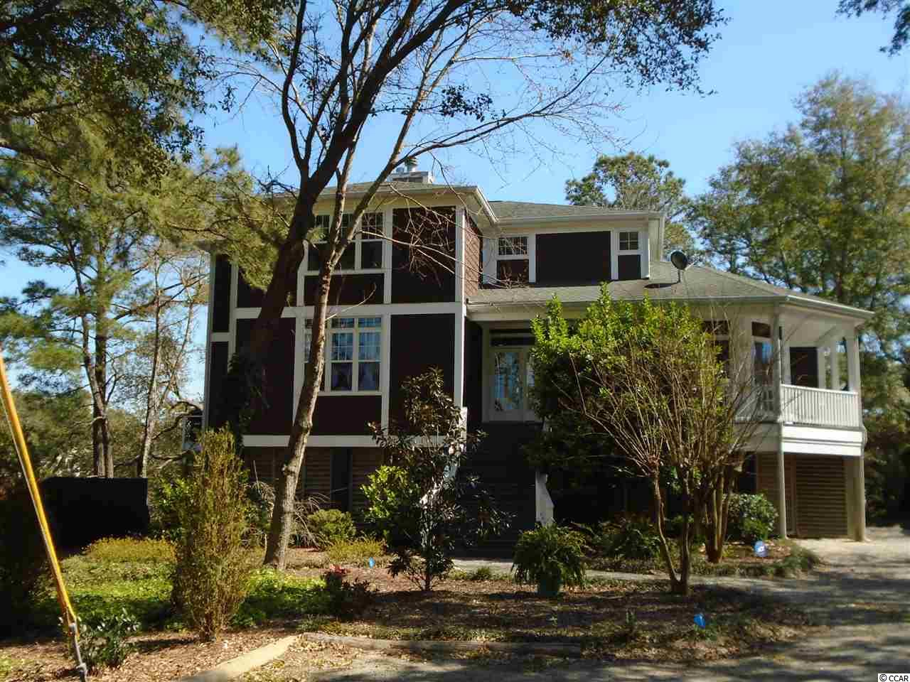 Welcome to 13760 Ocean Highway 17. The home has three bedrooms, 2.5 baths complete with fireplace, hardwood floors, screened porch with amazing marsh views. The natural landscaping makes for a maintenance free yard and a bird watcher's paradise. There is also a small dock.  No HOA. Plenty of outdoor space underneath the home to welcome family and friends.  Two new HVAC systems in 2017, hot water heater 2018, kitchen appliances 2017.  This private home is also convenient to shopping, restaurants and the beach is just a mile away!