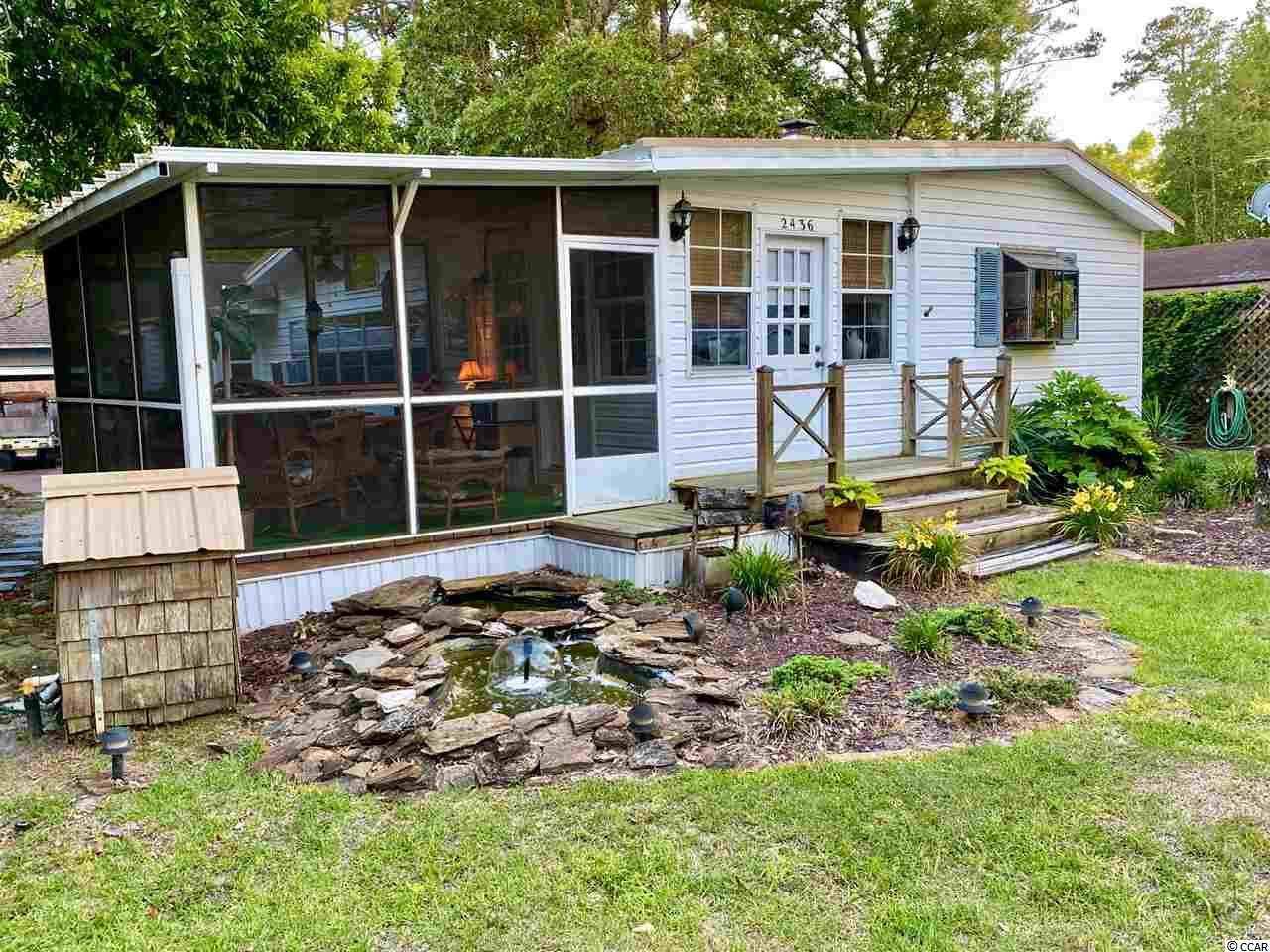 If you are looking for a Awesome Location thats close to the beach and boat landing, you have found it!  This 2 bedroom 2 bath Beach Bungalow has 3 kitchens and 3 different living spaces. You could live in one side and rent the other side out.  Nice lot with large enclosed storage shed and covered shed to store your bikes or Jet Skis.  Less than 1/4 mile to the boat landing.  No HOA and Plenty of room to park your Boat or RV. You will love relaxing on your screened porch while enjoying the cool ocean breeze!