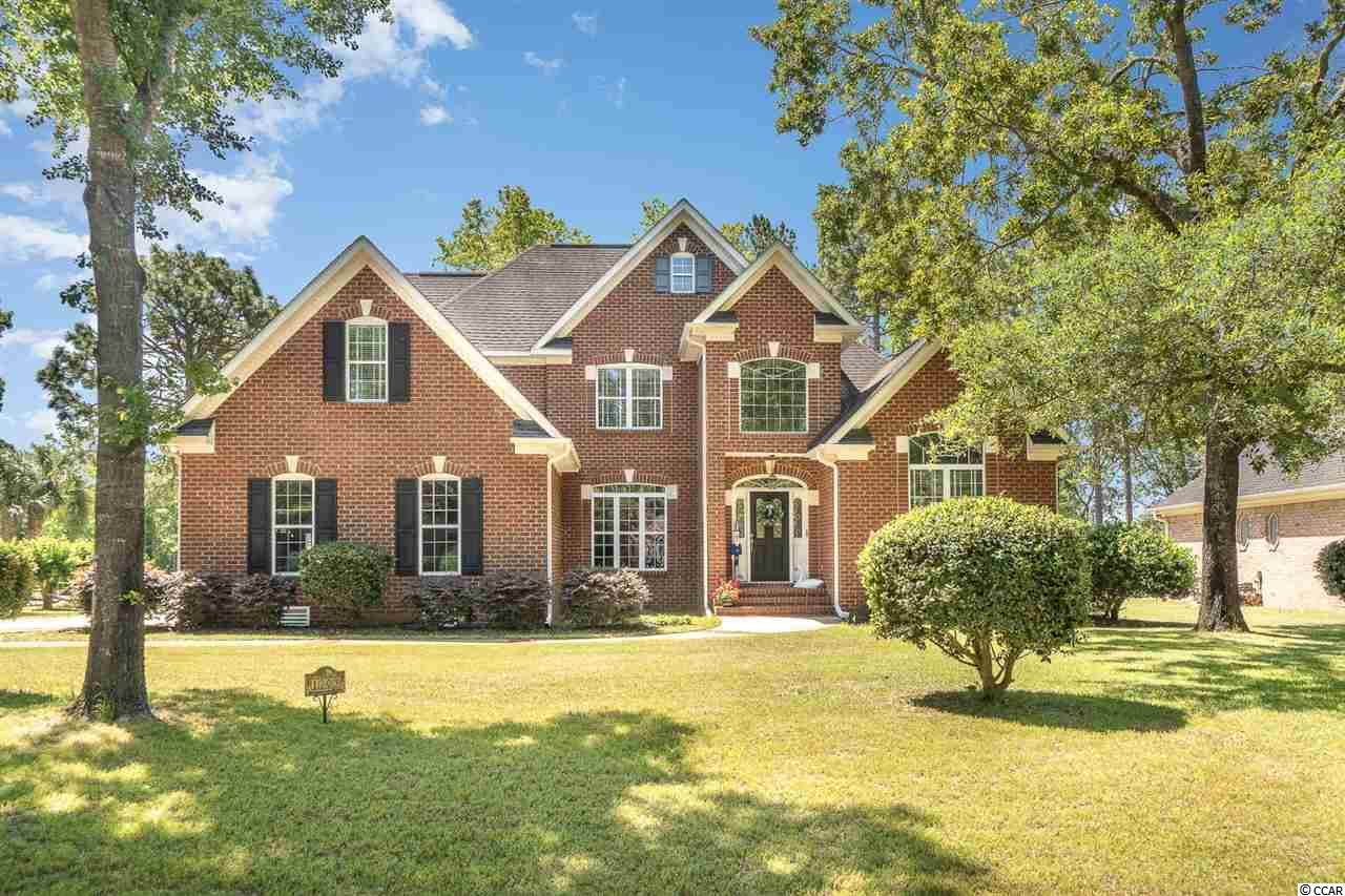 This gorgeous 4 bedroom all BRICK home is located in the Prestigious, Gated Prestwick Golf community on just under a 1/2 acre lot. The property has great views of the green on hole 6!  This home offers a large living space and plenty of room for those family get togethers, lots of windows allowing tons of natural light to enter your home, gorgeous wood floors and a beautiful fireplace.  The kitchen has beautiful countertops & cabinets, tiled backsplash, SS appliances & an island with storage.  The Master suite has a beautiful double tray ceiling, walk-in closet, double vanities, whirlpool tub & separate shower. The additional bedrooms are spacious with ample closet space.  Additionally there is a large office area & bonus room for your convenience. The deck and the back yard are great for entertaining friends and family.  This home really does have it all. Prestwick offers phenomenal pools and tennis amenities along with optional golf memberships and more! Just a short drive to all beaches, the airport, State Park and near all the best shopping, dining, attractions, entertainment that the Grand Strand has to offer. Schedule your showing today.
