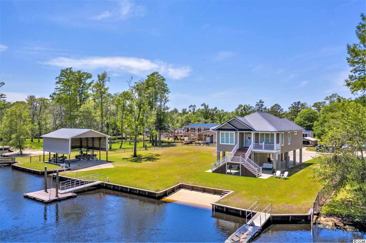 Perfect location along the beautiful Waccamaw River to build your dream home. Includes lots of river frontage, with a private boat ramp, floating dock, and boat storage shed (27'x34'x17' tall). Also has water and sewer already to the lot.  The lot is just minutes from downtown Conway, Myrtle Beach, and the entire Grand Strand areas. All the dining, shopping, and entertainment that they have to offer are easily accessible by land or by water. This river also connects you to the Inter-coastal Waterway, which spans the entire coast. So, not only can you visit all of the attractions close-by this area by boat anytime that you'd like, but you can also take longer trips to just about anywhere in the country as well. This river is a local favorite. It is known for its wonderful fishing, hunting, and water-sporting experiences. Fisherman, remember you can also get to the inlets in Little River or Murrells Inlet in no time at all from this property. You can even go off-shore anytime you feel like an adventure. Don't miss this opportunity! The adjacent lot/home property is also available for purchase. See MLS # 2009711.