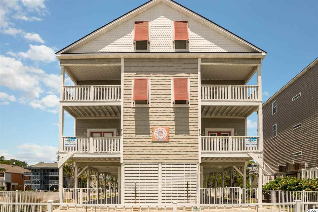 Come enjoy the beach life in this beautiful property just south of Main Street in North Myrtle Beach! Enjoy an ocean view from all balconies, or just step across the street to experience the sand, the sun, and the ocean! The first level has an open concept kitchen and dining space as well as 2 bedrooms and 2 baths. The second floor has 4 bedrooms and 3 baths. The third floor has 1 bedroom and 1 bath, as well as an awesome game room space that could easily convert to additional sleeping space. New ceramic tile throughout the home. Beautiful beach decor. Shared pool on property. Lots of space for parking underneath. Great investment property or beach getaway. Call today to see it for yourself!