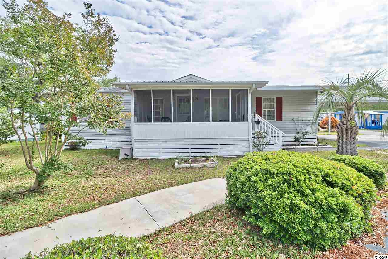 Located in Murrells Inlet in the highly sought-after Inlet Oaks Village, is this spacious home with generous closets, large open kitchen and split floor plan. You have a charming screened-in front porch, small rear porch, and large separate storage shed. This home comes mostly furnished and is move-in ready today! Inlet Oaks Village, a 55+ community boasts beautiful fishing ponds, pool, and amenity center with plenty of activities. There is storage for residents to store boats, trailers etc. Just 15 miles south of the Myrtle Beach Airport you are only a few minutes to the Marshwalk, restaurants, shopping, Huntington Beach State Park and Brookgreen Gardens.