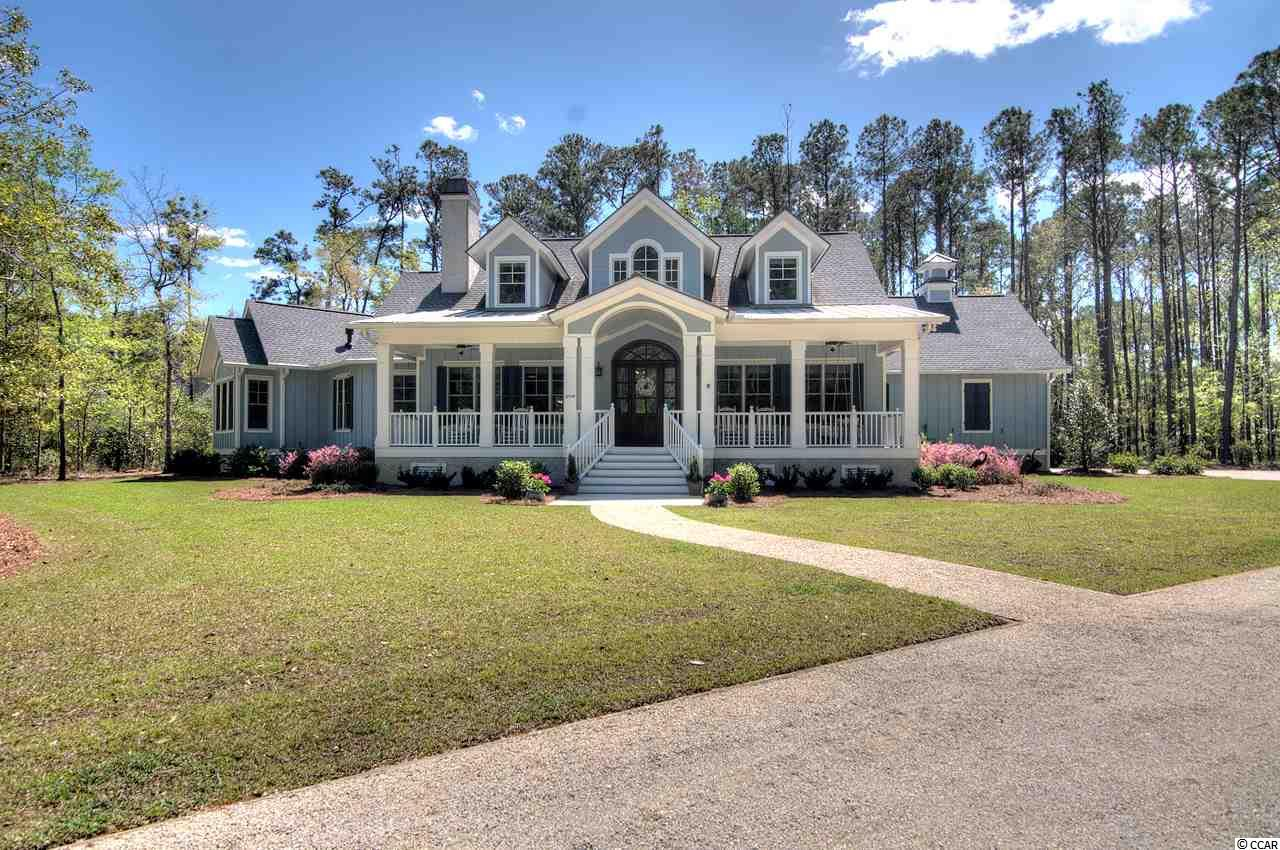 Distinctive coastal home offers incomparable ownership within the Oceanside section of Prince George. A historically significant and pristine tract of 1900 acres, Prince George offers only 150 unique single-family home sites stretching from the Atlantic Ocean to the Waccamaw River.   Completed in October 2016, this immaculate two-story, 3 to 5-bedroom, 4.5 bath home on 3.38 acres of private woodland boasts a beautiful lake front setting and close proximity to private beach access.   Numerous architectural details include reclaimed pine plank floors, tray ceilings, crown molding, built-in niches, detailed cabinetry, large customized closets and more.   Gourmet kitchen boasts large work island w/ quartz and granite counters, deep double sinks, walk-in pantry, Sub-Zero and Thermador SS appliances w/ gas range, dual built-in ovens (including a convection) and warming drawer.   Great Room offers pristine lake view, cabinetry, and masterful stacked-stone wood burning fireplace.  Open dining area includes wine display rack, glassware cabinets and stunning reclaimed railroad boxcar plank serving counter.  Main floor master suite has gas fireplace, lake view sitting area, en suite bathroom w/ double-head shower and whirlpool tub, and en suite gym (alternatively, nursery or office).   Home office w/ lake view (or 2nd main floor bedroom) off front foyer.  On main floor are also a Chef's office, powder room, and large laundry room w/ sink and extra space (e.g., refrigeration).   The second level landing splits to the right, where there is a media room (or bedroom option) and a full bath.  Splitting to the left, are 2 more bedrooms and 2 full baths.   Extended oversized side-loading garage includes large workshop, storage, and outdoor shower. Fenced-in back yard. Concrete fiber siding. Two dual-zone HVAC systems. Two tankless water heaters. Encapsulated crawl space. Large walk-in attic.   Prince George boasts unspoiled natural beauty and ample amenities. The Oceanside clubhouse 
