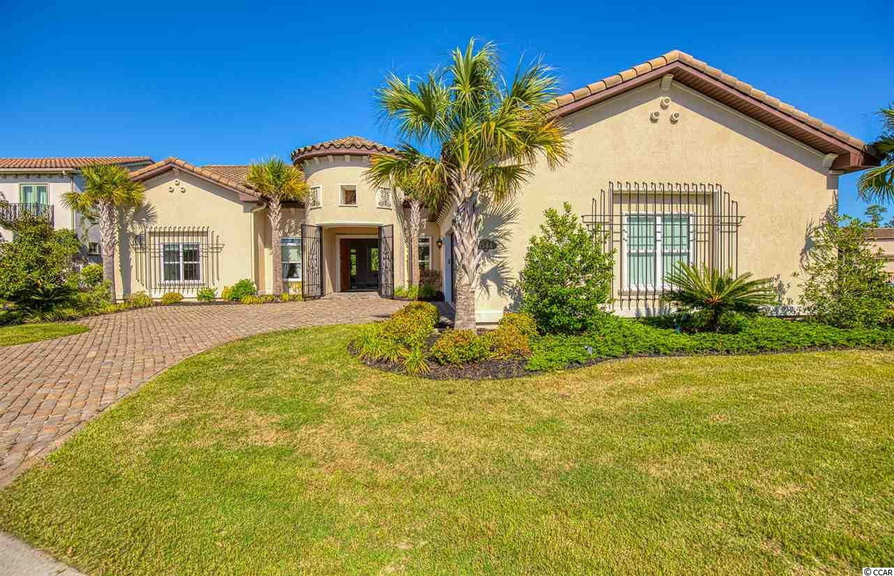 This Amazing Home is located directly on the Grande Dunes Member Club Golf Course on the 18th hole.... the Members Club at Grande Dunes is in the most exclusive neighborhood of Myrtle Beach. This custom homes has been used as a second home and built in 2014 it shows brand new. The spacious open floor plan is great for entertaining and offers lots of natural light and the views are breath-taking.  ALL ON ONE FLOOR!!!!  This home features a large gourmet kitchen, large bedrooms, a bonus room to be used as a flex room or 4th bedroom. Enjoy your outdoor kitchen and Lanai  overlooking the 9th and 18th fairway of the Members Club Golf Course. This home is very unique and is 1 of 3 Homes that can be rented short term and comes with a membership to the Members Club and the Direct Ocean Front Ocean Club. The Ocean Club, an exclusive oceanfront clubhouse with a resort pool, restaurant, and private beach front access.  This Home could be a Golfers Paradise with the Members Club located very close for dining and take-out.... Whow what an opportunity to own in this beautiful Gated Community. Very RARE opportunity for the rental income or second Home if this HOME is of interest to you. So many options to fit your needs.... Also great for a Primary Home!!!!