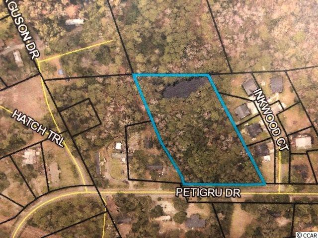 Over 2 acres of land in Pawleys Island, located west of Hwy 17, behind the Publix shopping center. Perfect for a small residential development, or large residence. Small pond on rear of property. Close to schools, golf courses, beaches, shopping and restaurants. Call listing agent w any questions.