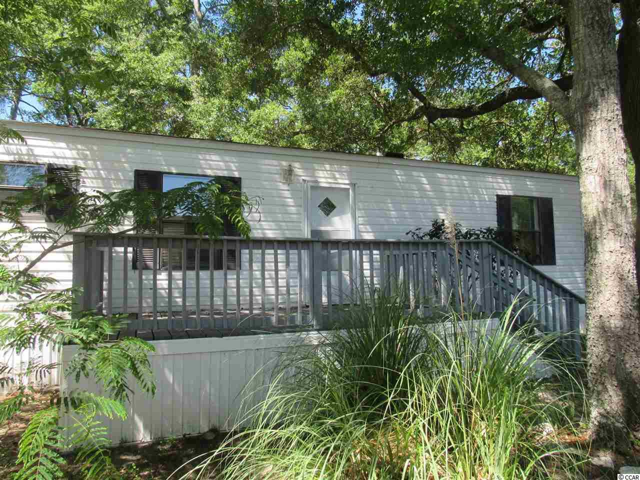 This home is all about location! Within walking distance to the Marshwalk and all Murrells Inlet has to offer - waterfront restaurants, shopping, entertainment, nature and more! This home features 2 bedrooms, 2 full baths, new flooring throughout, split bedroom floor plan, separate laundry room, master bedroom with en suite bath, front/back decks and so much more. Key Largo is a lovely and quiet community perfect for a beach retreat or stay all year! Book your showing today!