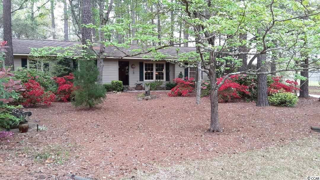 Nice home nestled within tall pines and situate back from S. Island Road for complete privacy.  Home has been well maintained with a beautifully landscaped yard and views of Winyah Bay.